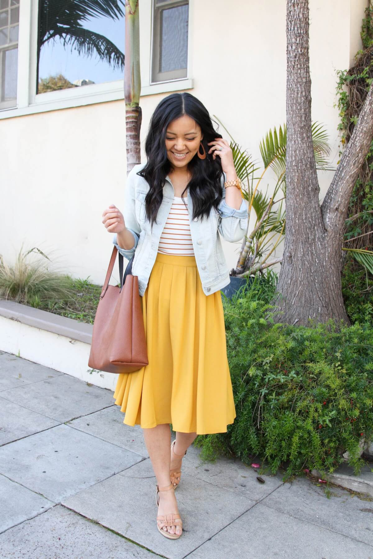 denim jacket outfit: denim jacket + striped tee + yellow skirt + nude sandals + tan earrings + brown tote