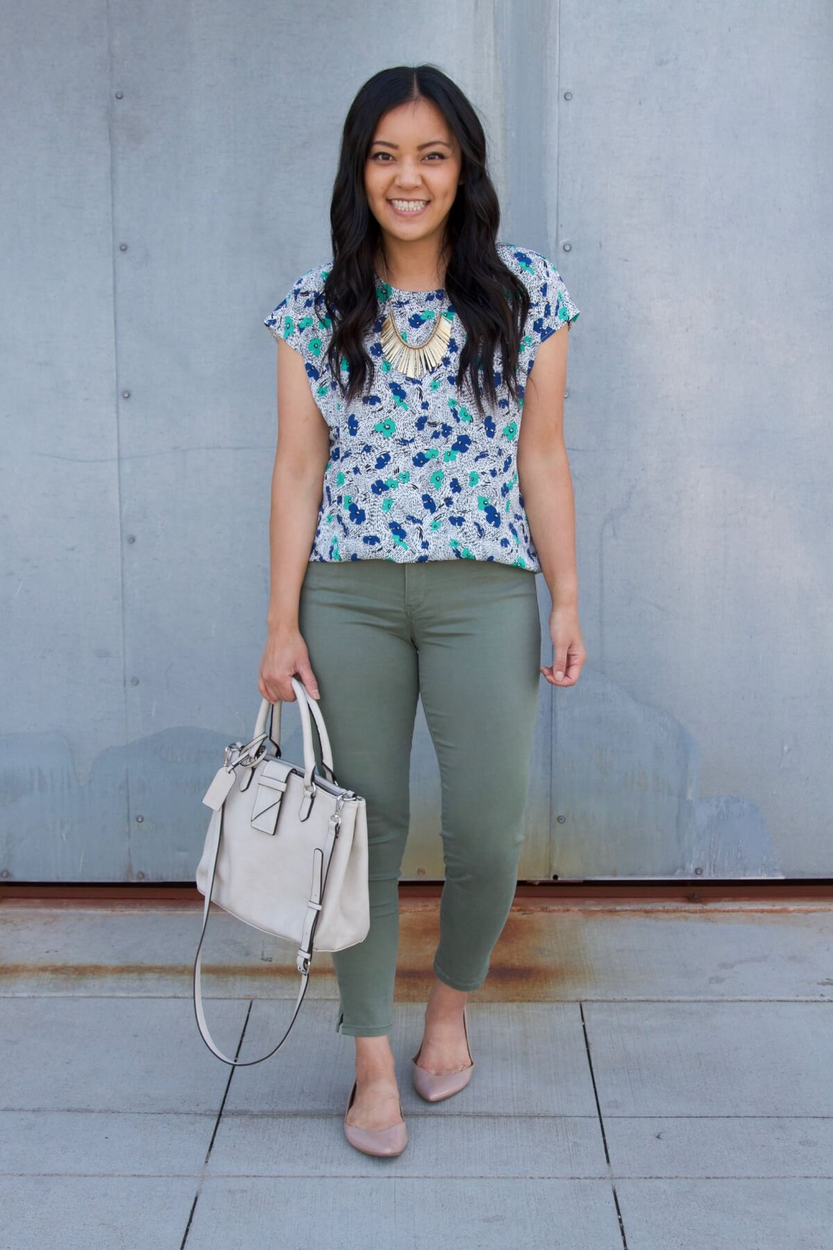 Work Outfit: blue and green floral top + olive pants + nude flats + statement necklace + white bag