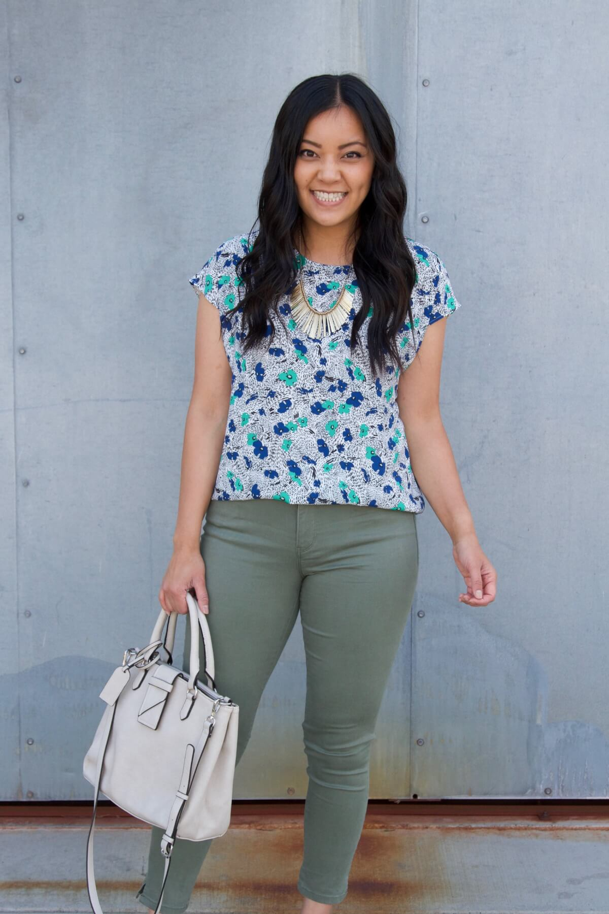 Work Outfit: blue and green floral top + olive pants + statement necklace + white bag