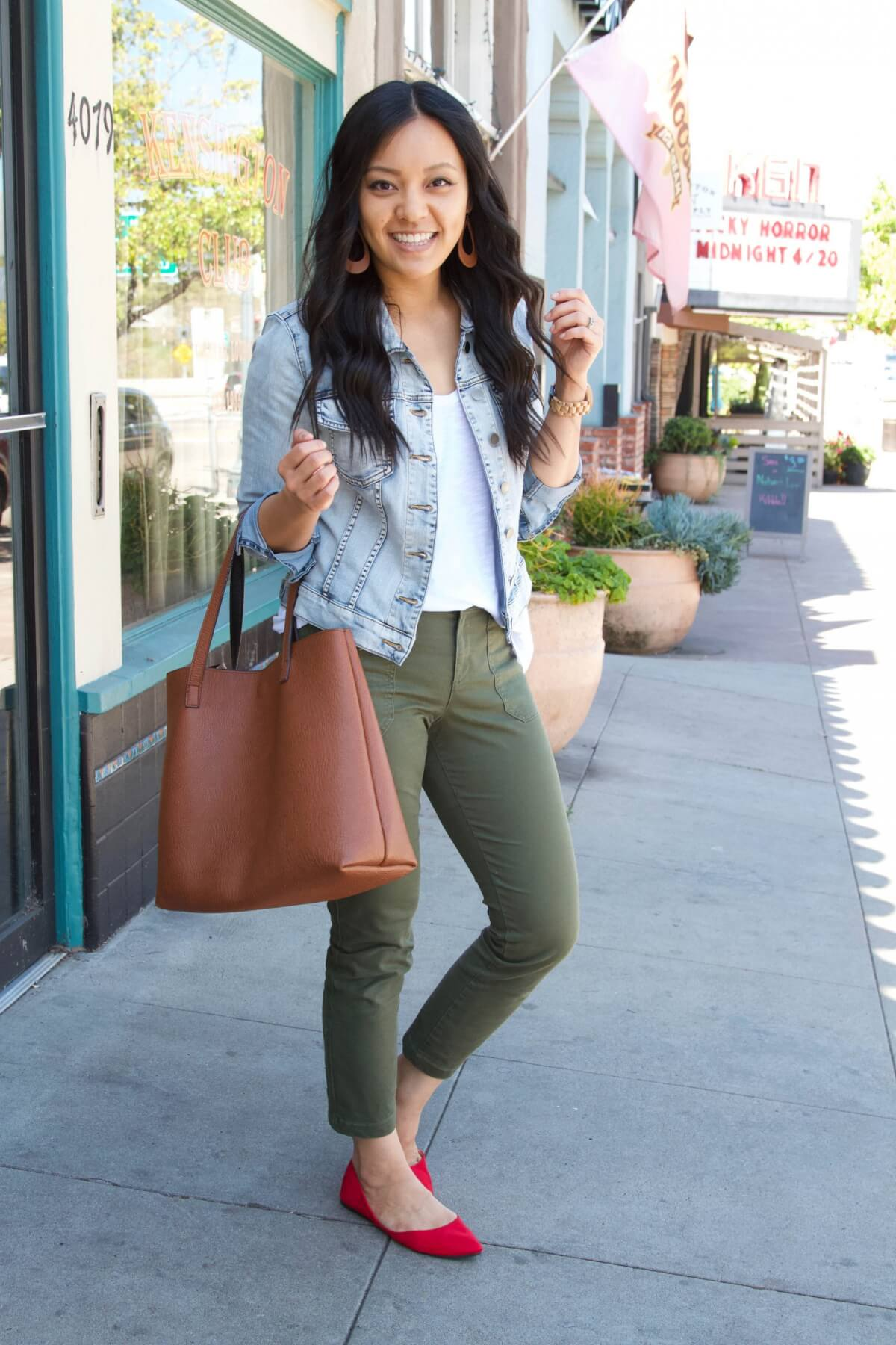 denim jacket outfit: denim jacket + white tee + olive pants + red flats + tan earrings + brown tote