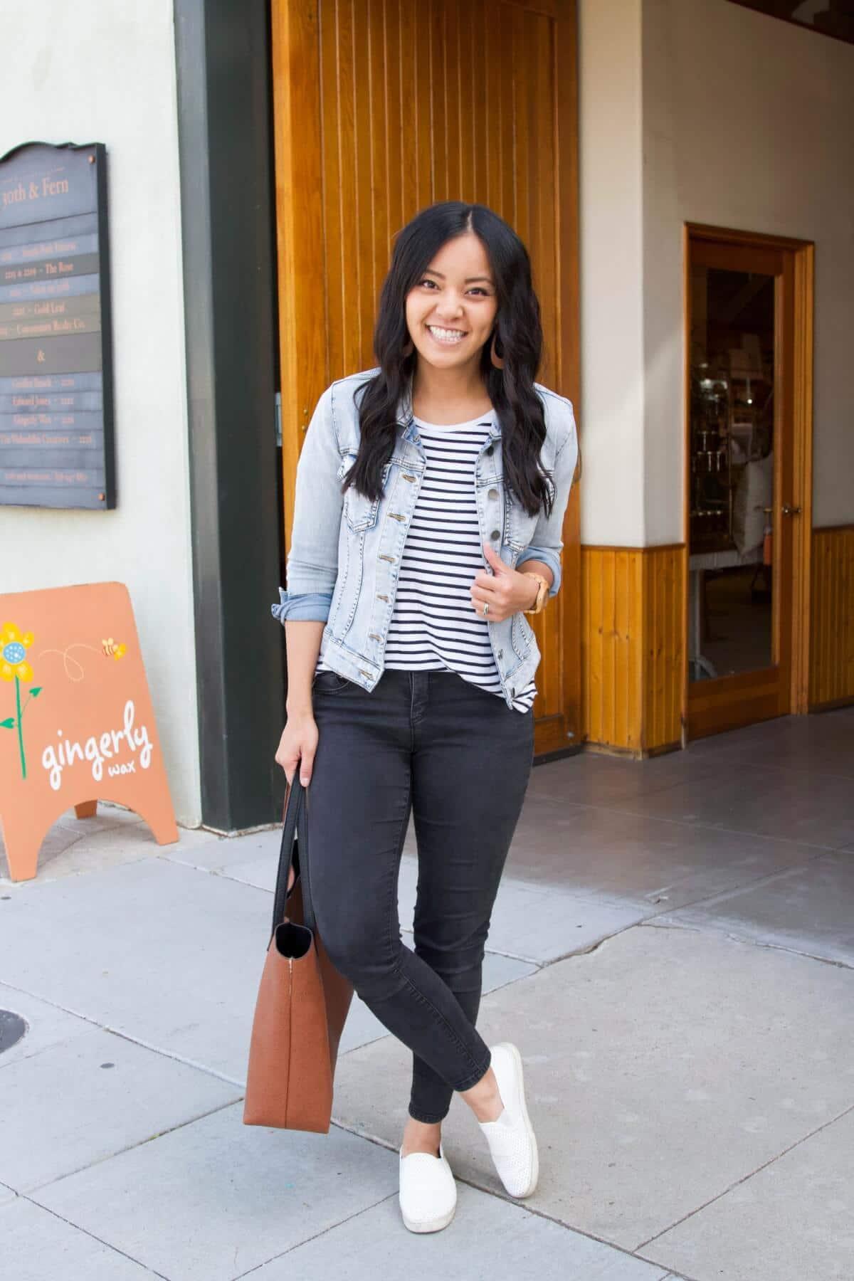 Classic Outfit: striped tee + black jeans + denim jacket + white sneakers + tan earrings + tan tote