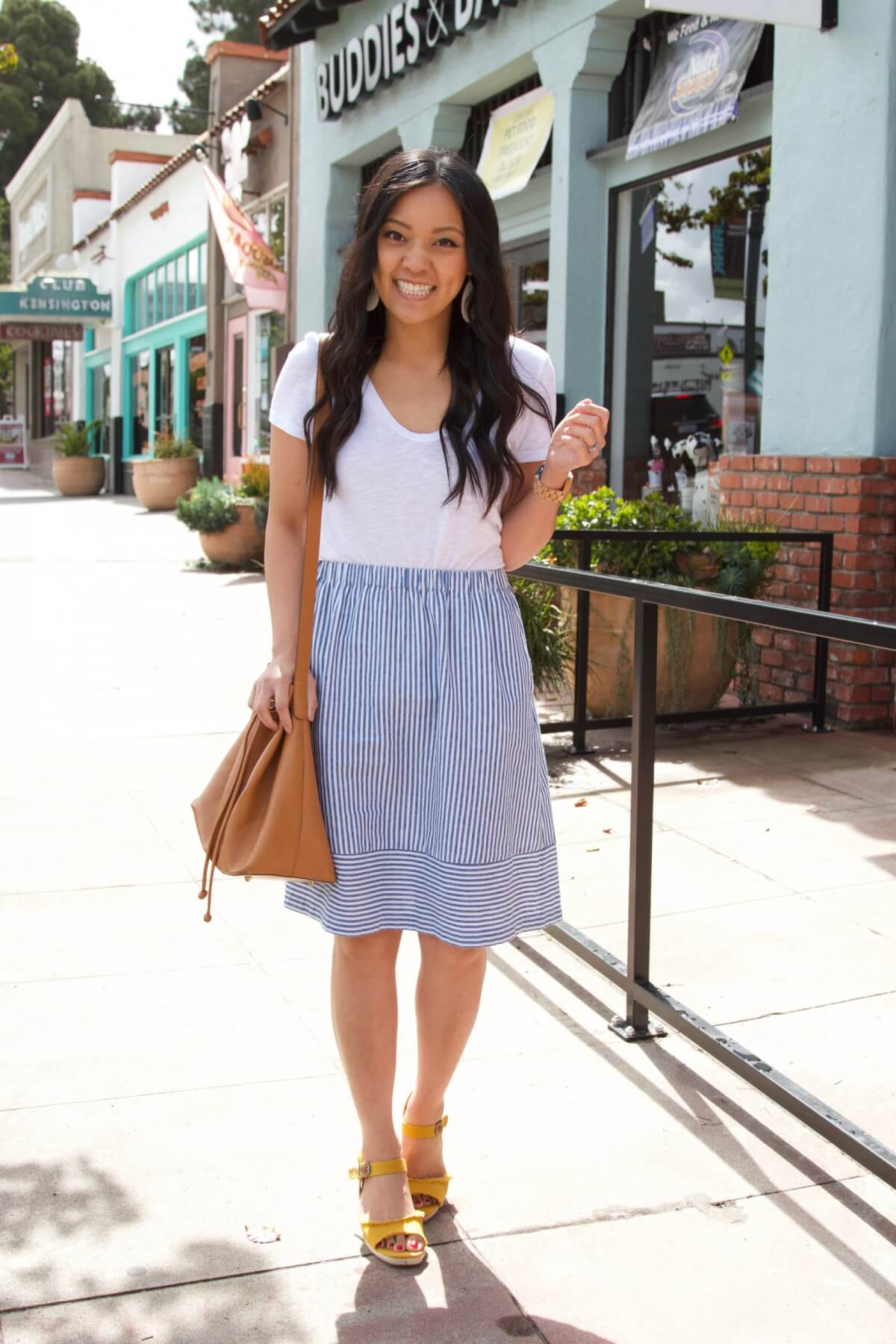 Classic Outfit: white tee + striped skirt + yellow heels + tan bag