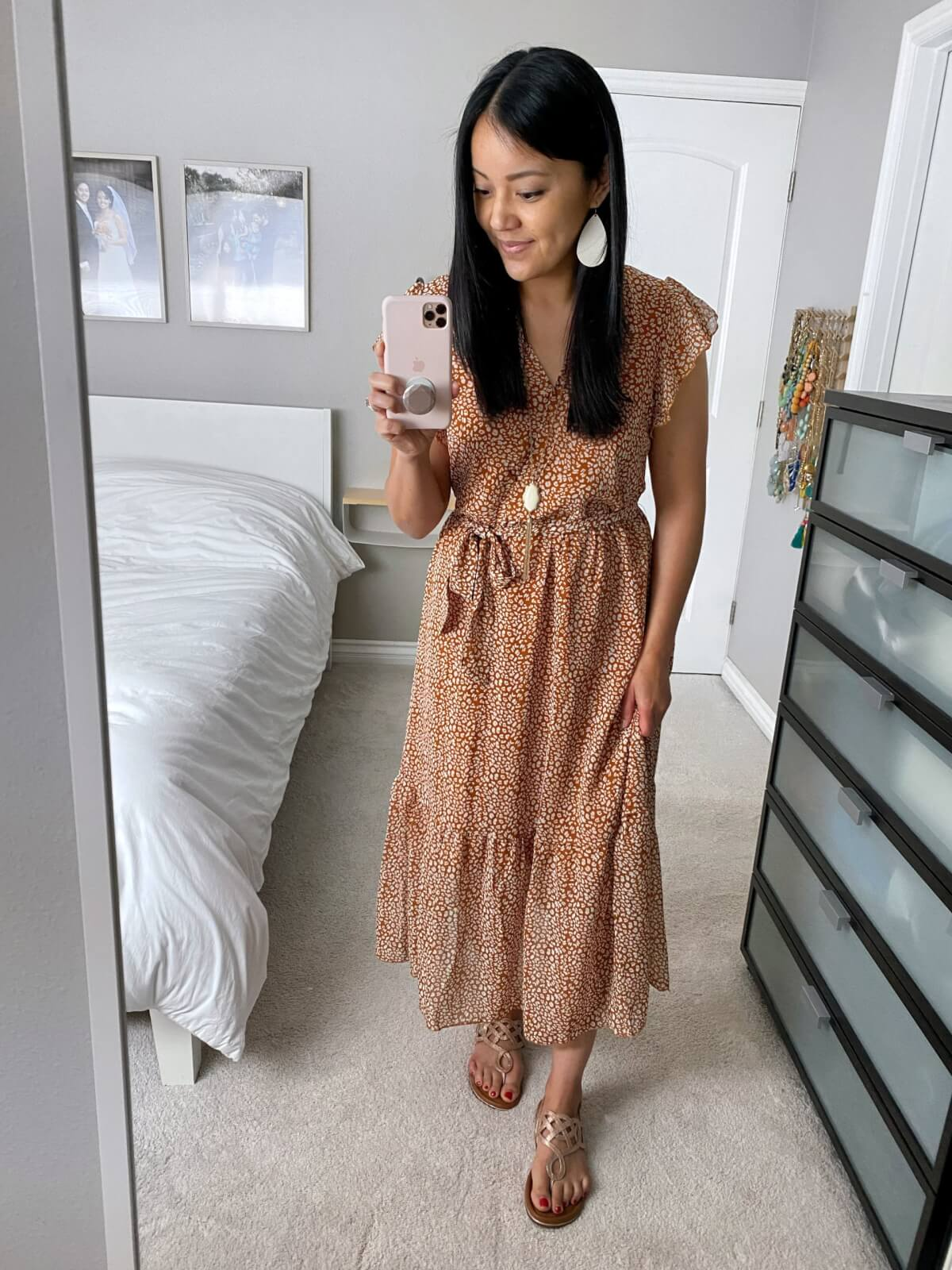 Dressy Outfit: Amazon rust bohemian tiered midi dress + metallic gold sandals + white earrings + pendant necklace