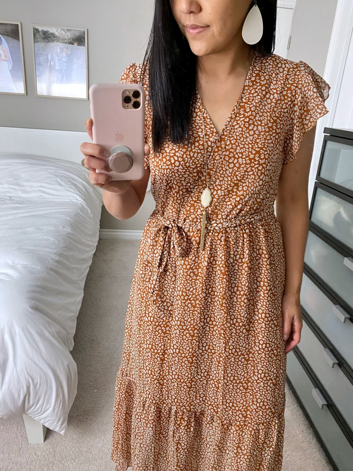 Dressy Outfit: Amazon rust bohemian wrap tiered midi dress + white earrings + pendant necklace