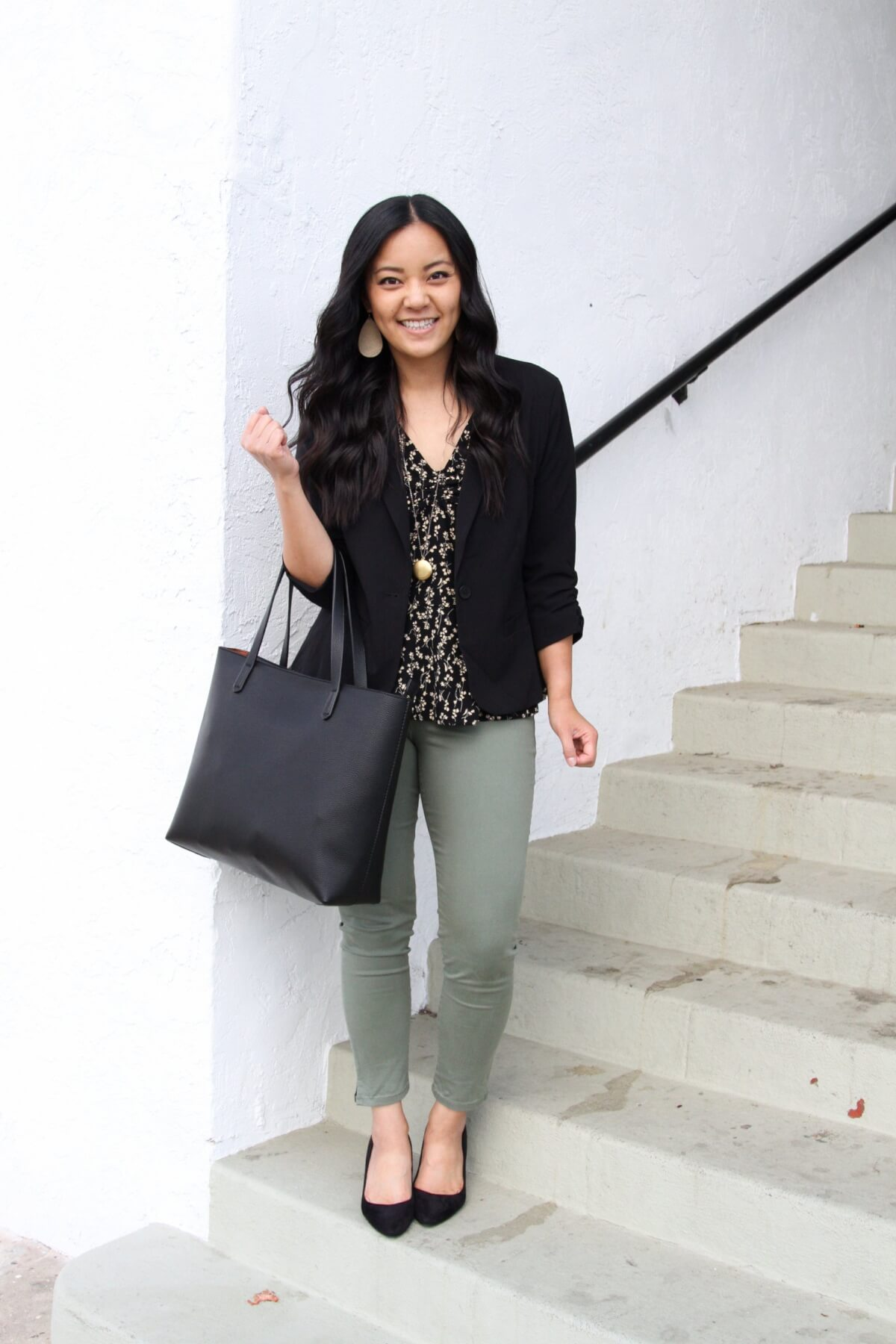 Work Outfit: black blazer + black and ivory floral top + olive pants + black pumps + pendant necklace + black tote