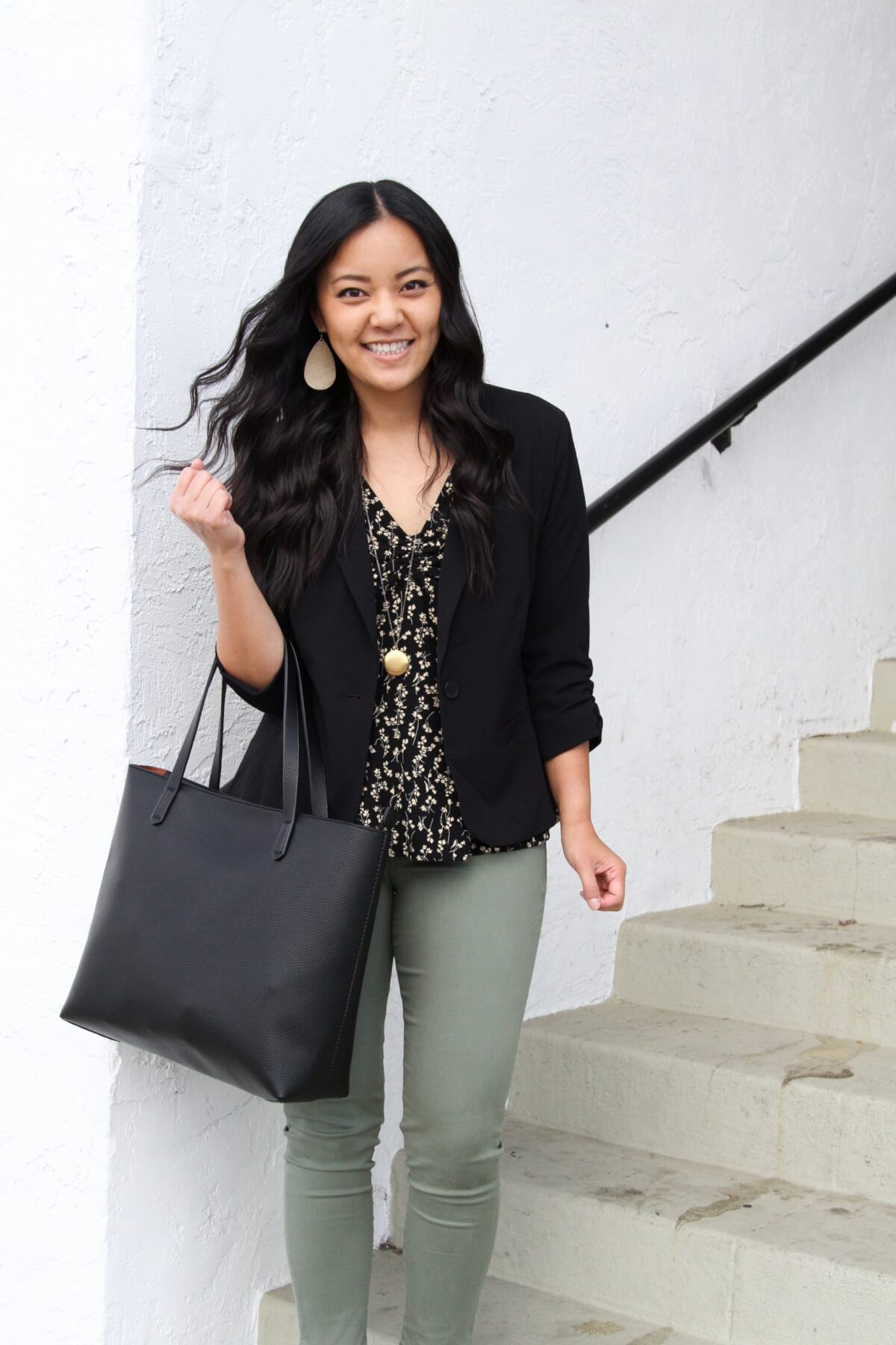 Work Outfit: black Eliza blazer + black and ivory floral top + olive pants + off-white earrings + pendant necklace + black tote