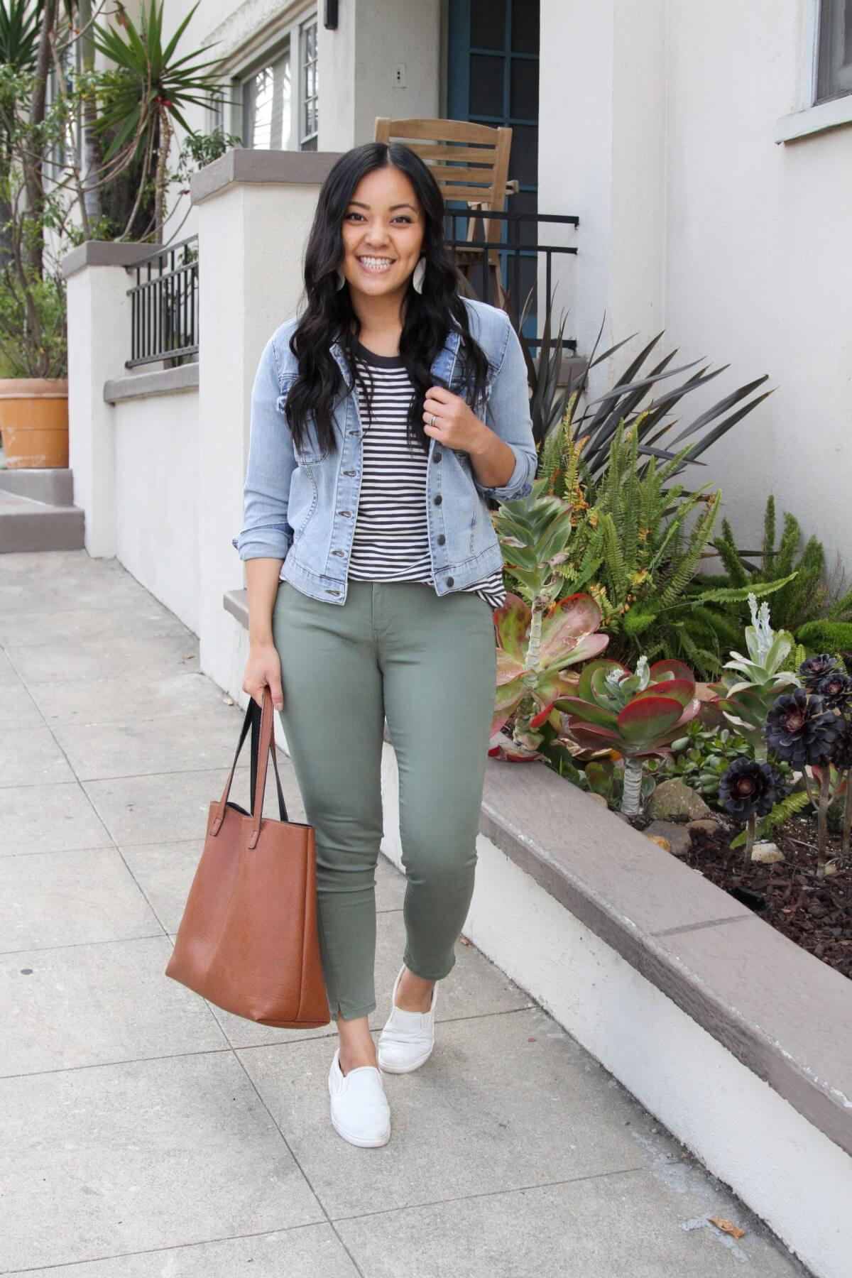 Casual Outfit: denim jacket + black and white striped tee + olive pants + white slip-on sneakers + tan tote + white earrings
