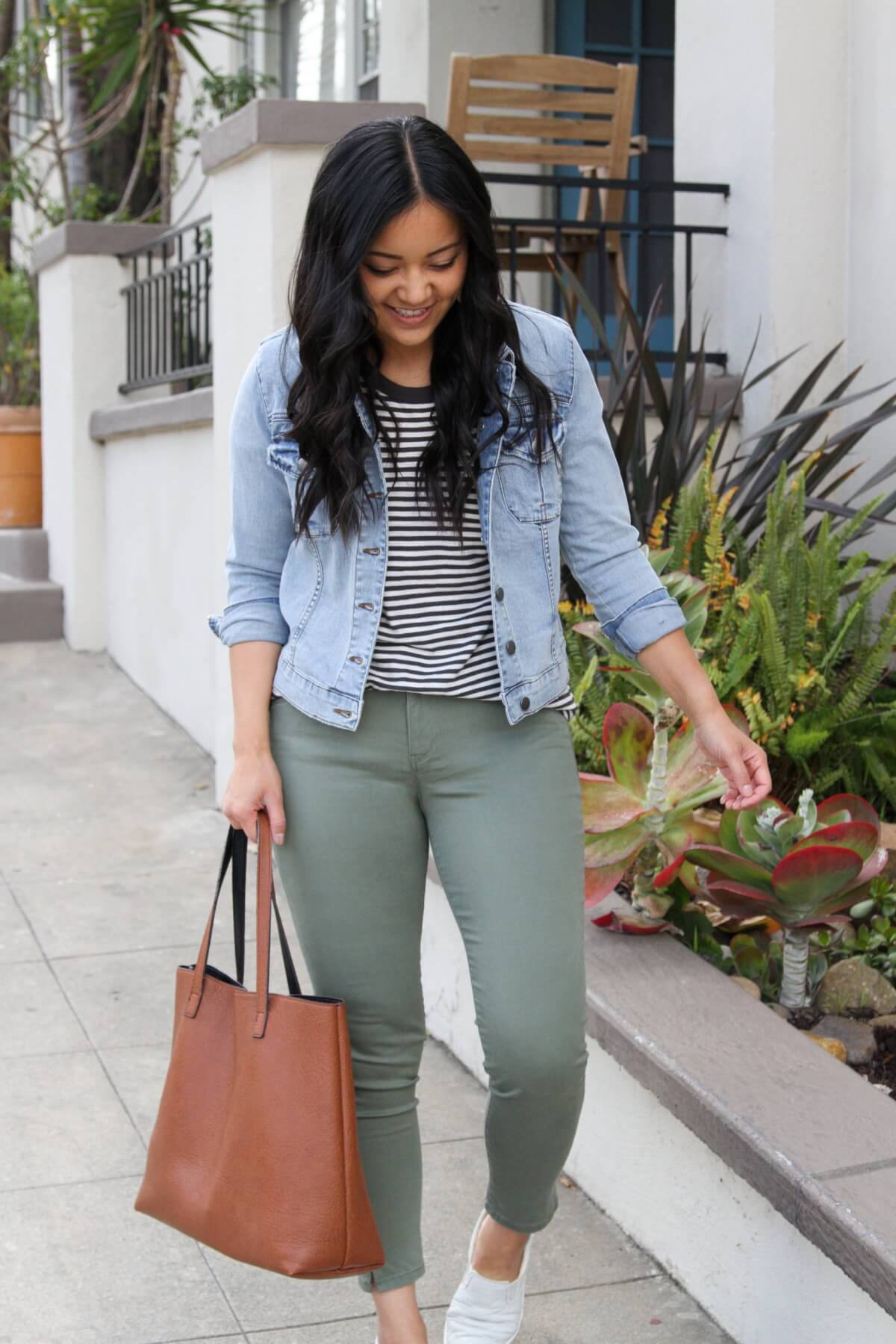 Casual Outfit: light denim jacket + black and white striped tee + olive pants + white slip-on sneakers + tan tote