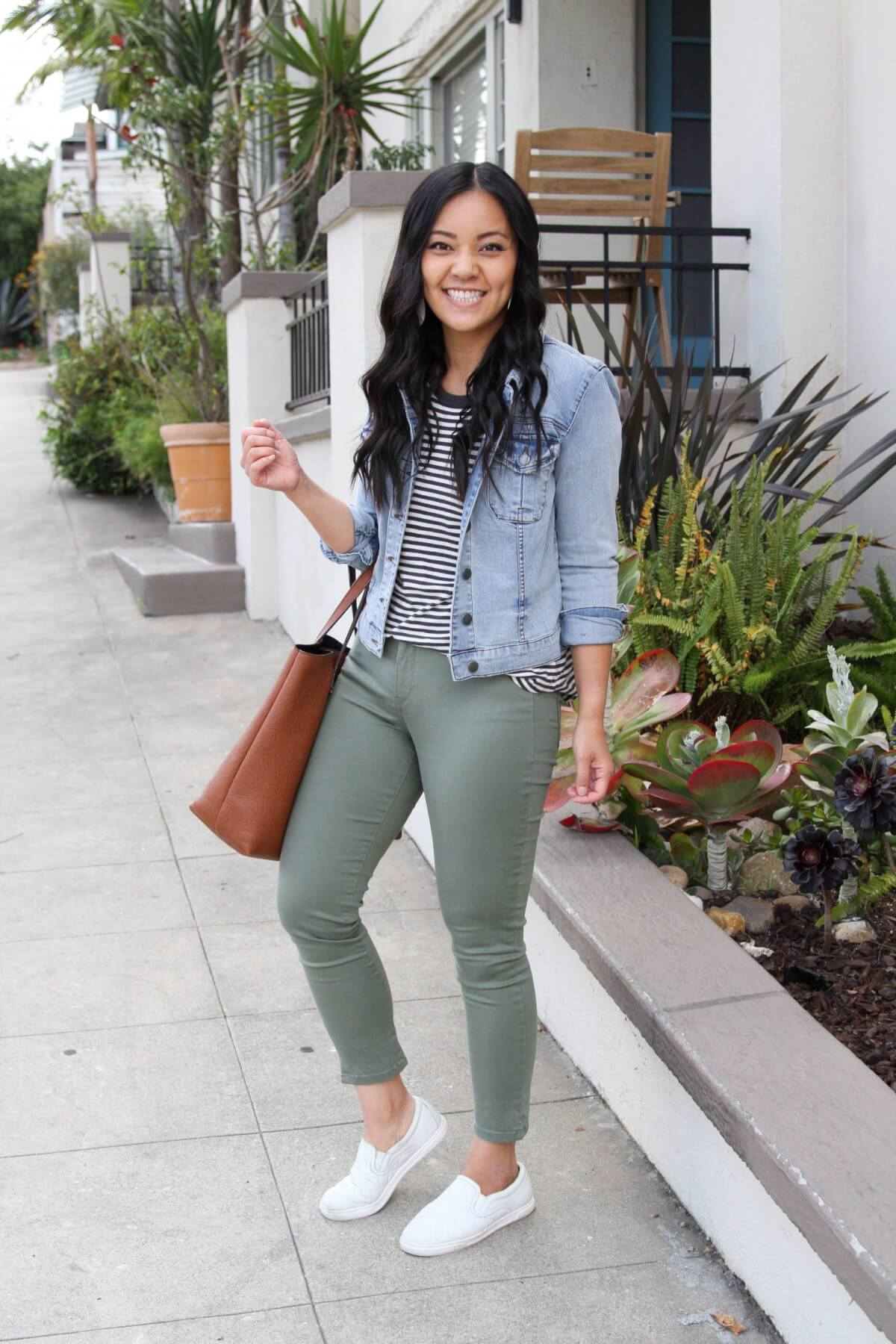 Casual Outfit: denim jacket + black and white striped tee + olive pants + white slip-on sneakers + tan tote