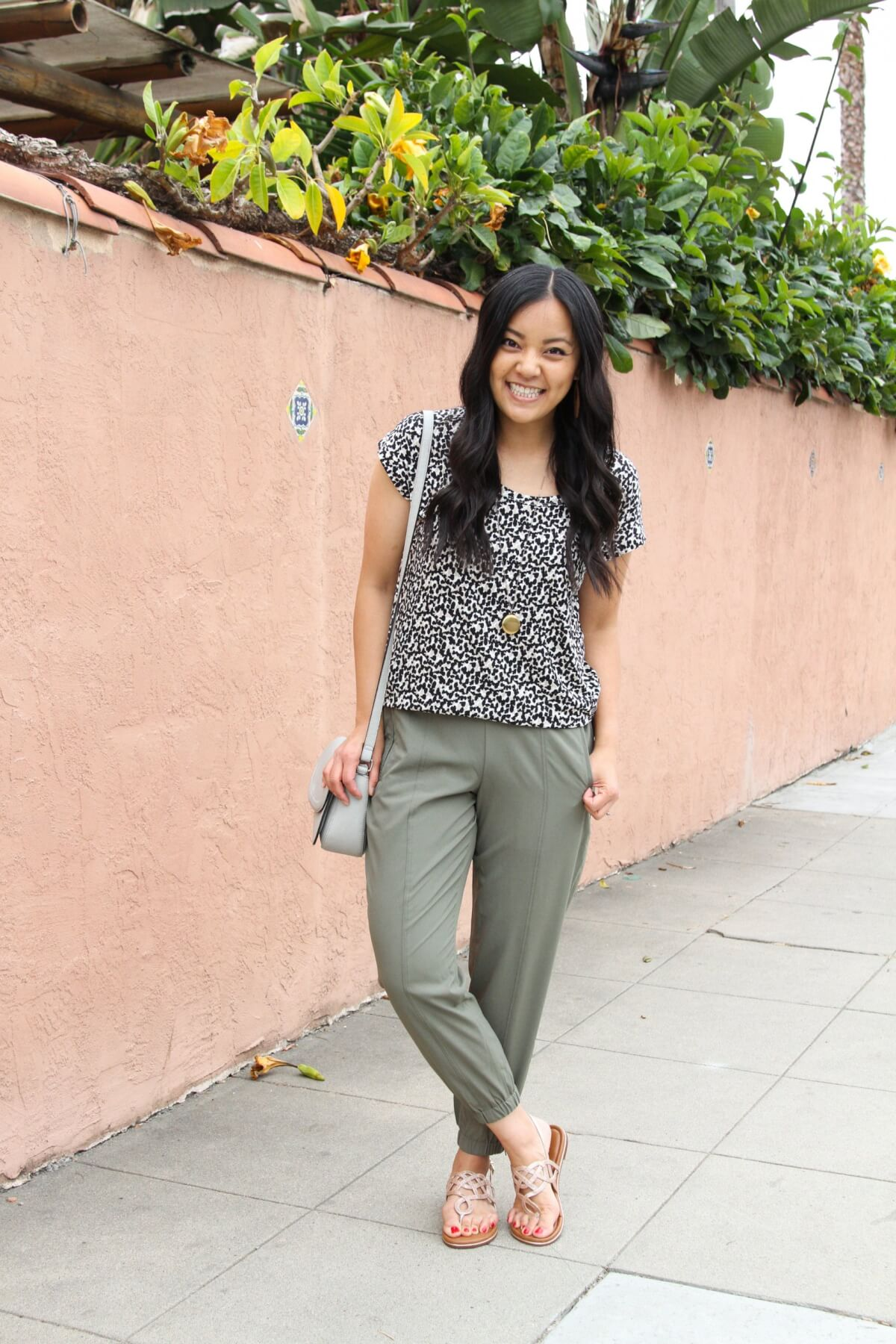 Casual Outfit: leopard tee + olive joggers + metallic sandals + pendant necklace + grey crossbody bag
