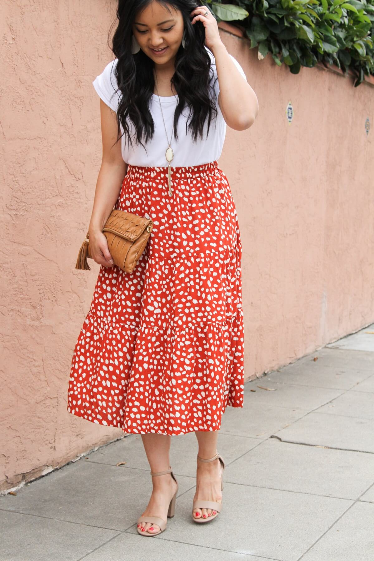 Summer Shoes Dressy Casual Outfit: white tee + red and white tiered midi skirt + nude open toe heels + white earrings + pendant necklace + cognac clutch