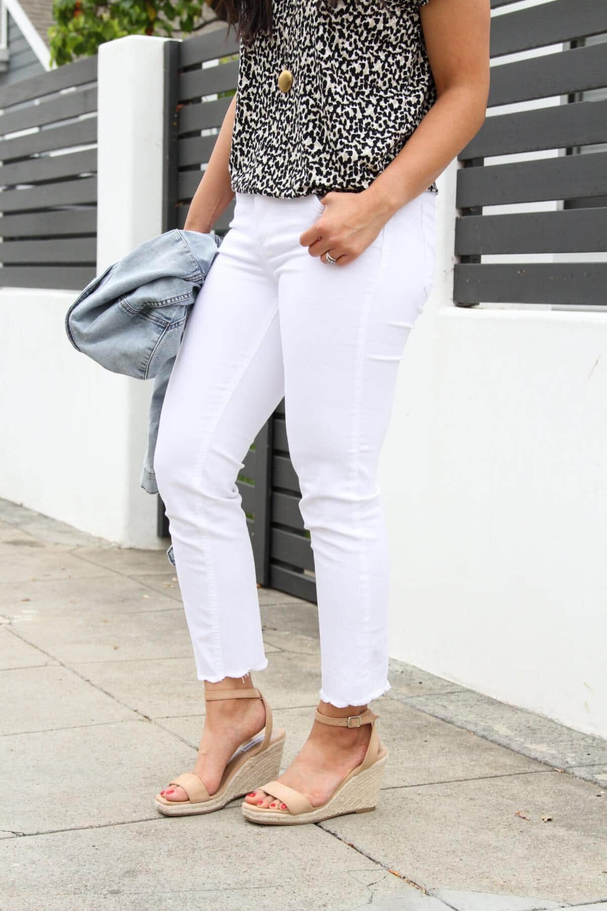 Summer Shoes Casual Outfit: black white beige spotted tee + white jeans + denim jacket + nude espadrille wedges + pendant necklace