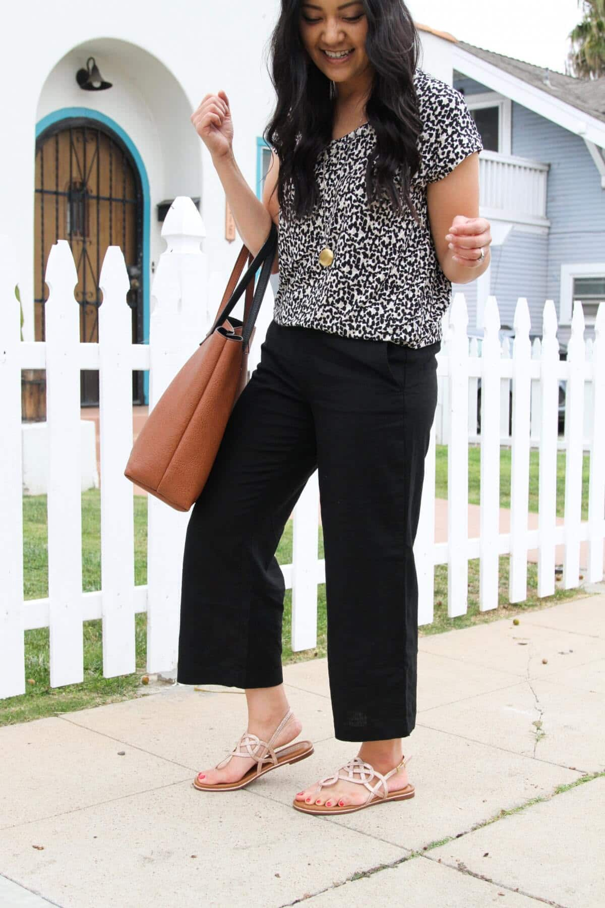 Summer Shoes Elevated Casual Outfit: black white beige spotted tee + black wide leg linen pants + metallic flat sandals + pendant necklace + tan tote side