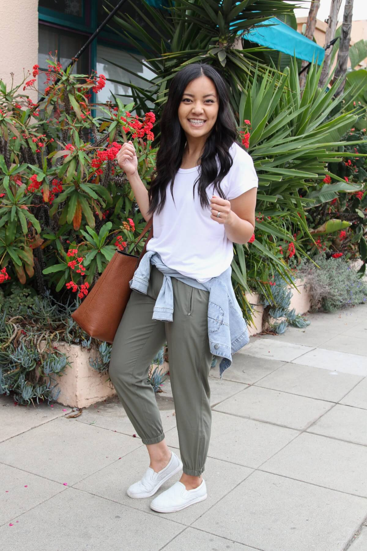 Summer Pants Casual Outfit: olive lightweight joggers + white tee + denim jacket + tan tote +white slip-on shoes