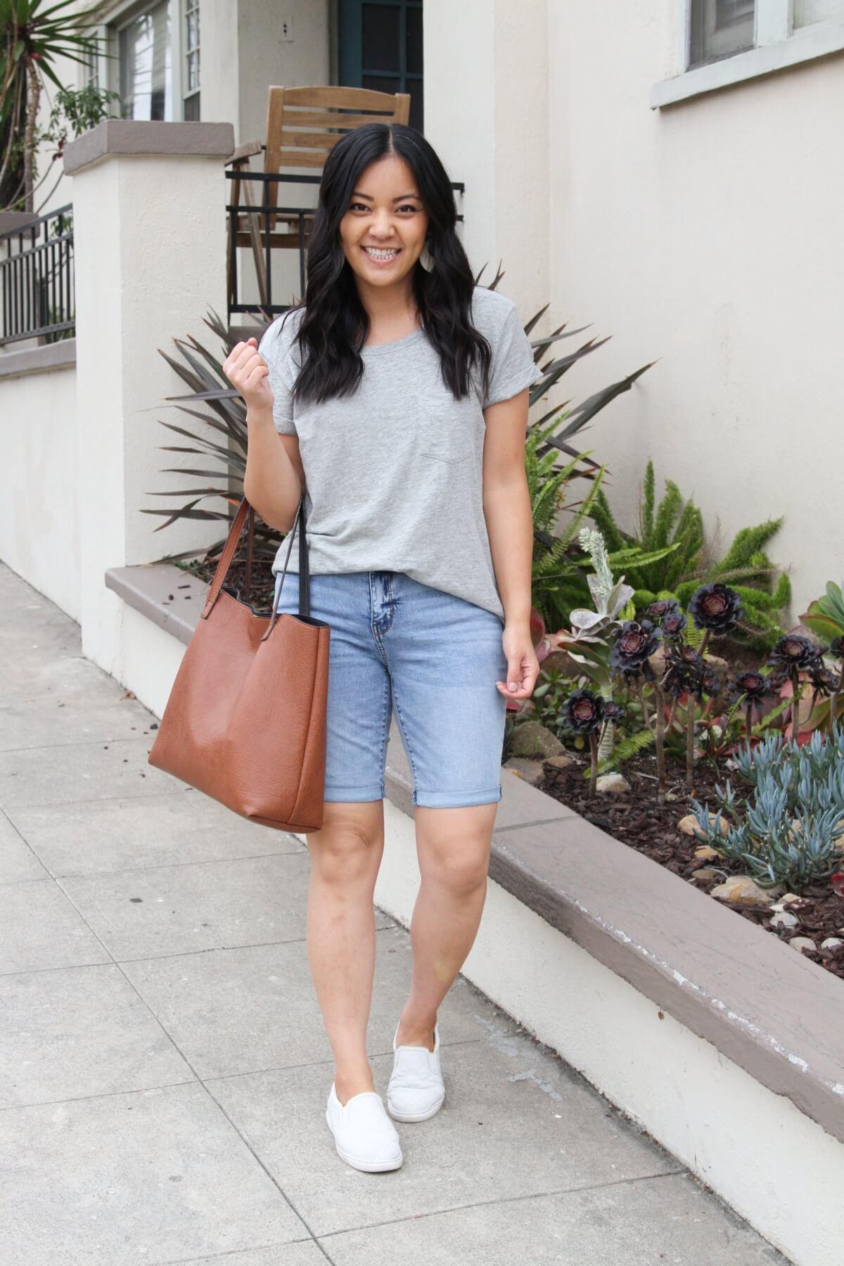 Casual Outfit: grey tee + denim bermuda shorts + white slip-on sneakers + white earrings + tan tote