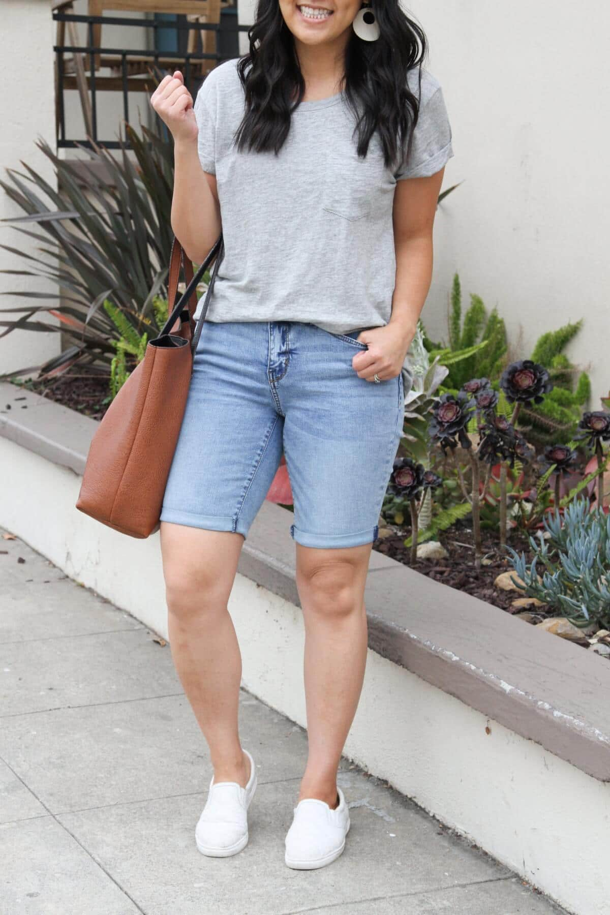 Casual Outfit: grey tee + denim bermuda shorts + white sneakers + white earrings + tan tote