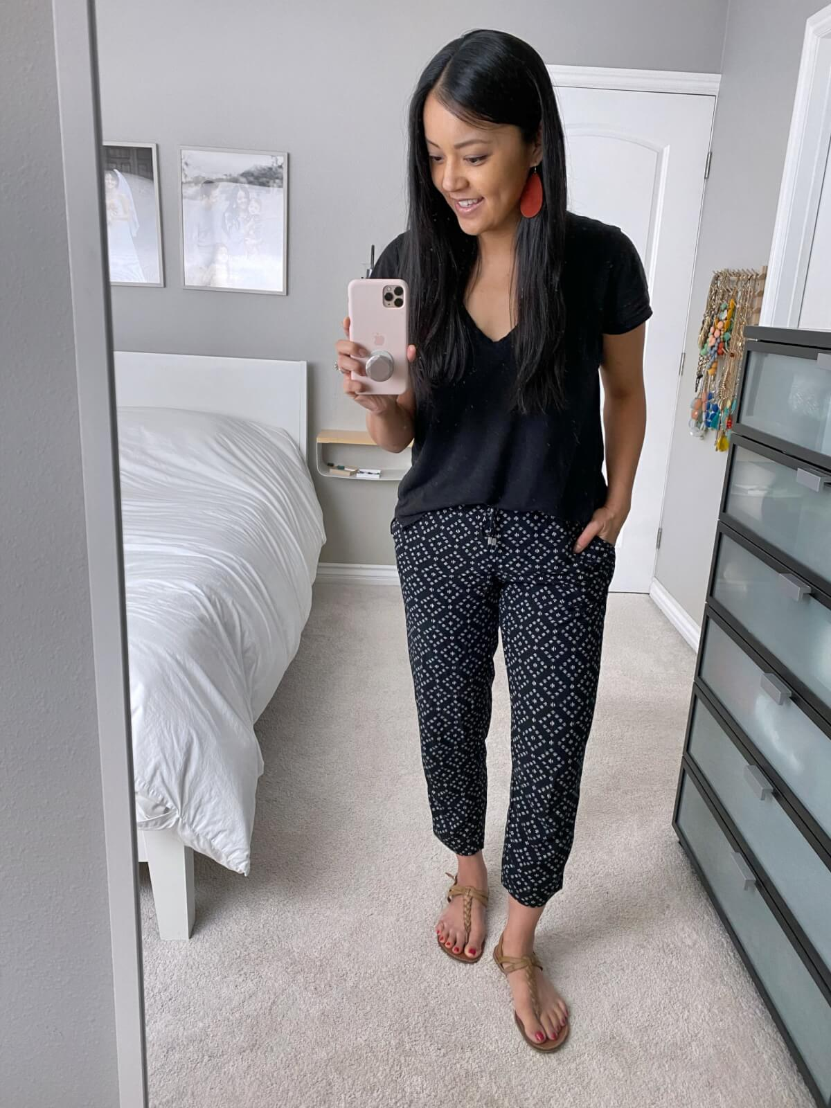 Summer Pants Casual Outfit: black tee + light geometric print pants + red earrings + nude sandals
