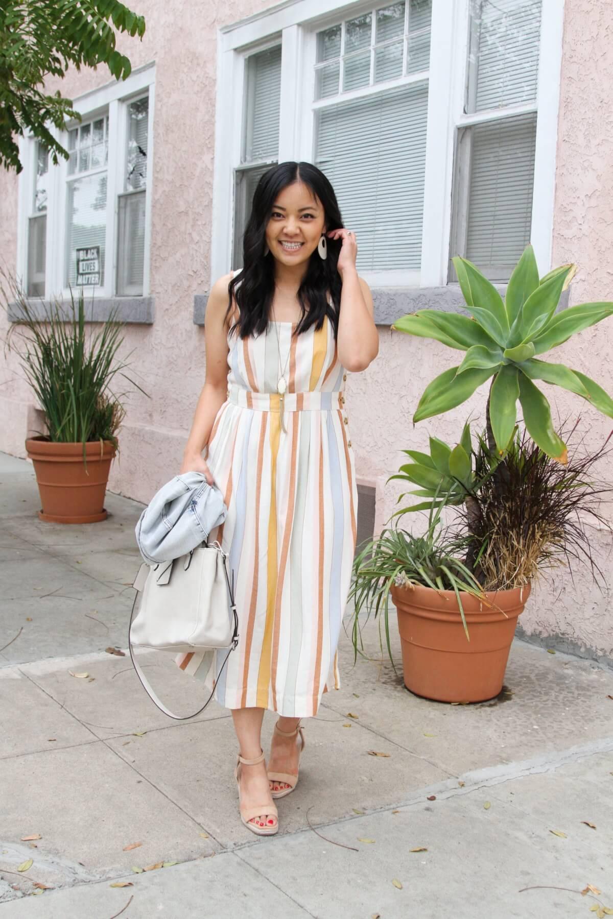 Dressy Outfit: pastel striped midi sleeveless dress + nude wedges + pendant necklace + white earrings + denim jacket + white bag