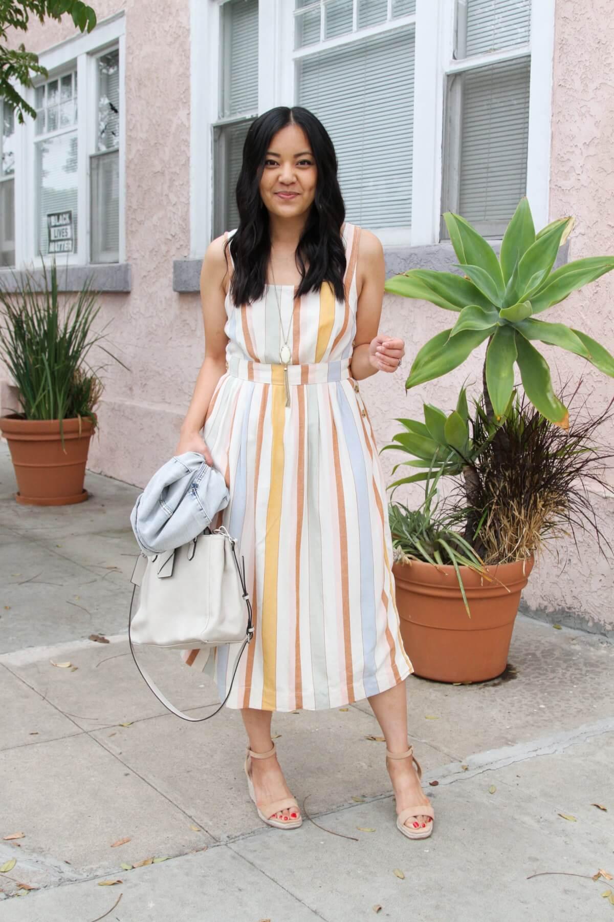 Dressy Outfit: pastel striped midi dress + nude wedges + pendant necklace + denim jacket + white bag