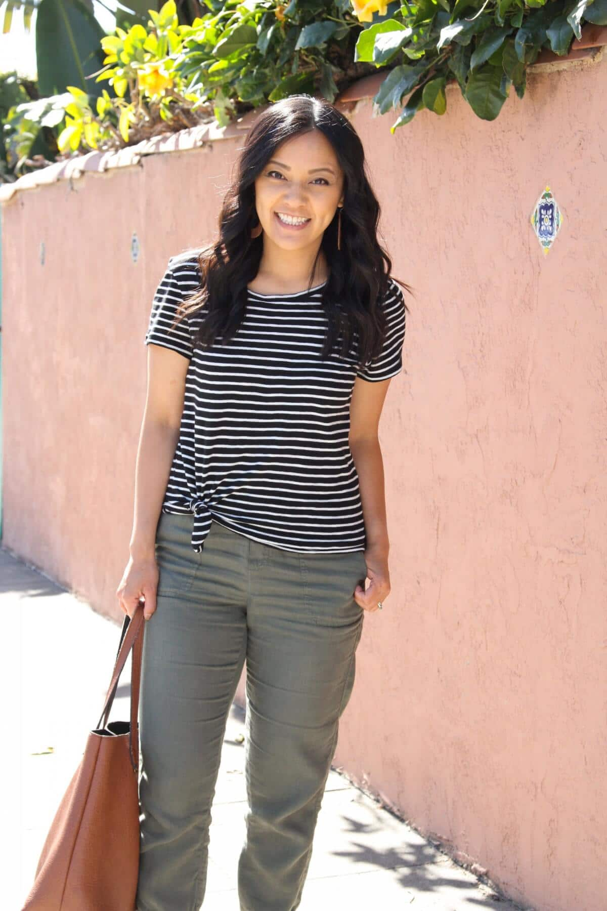 Casual Outfit: black and white striped tee + olive joggers + tan tote + tan earrings