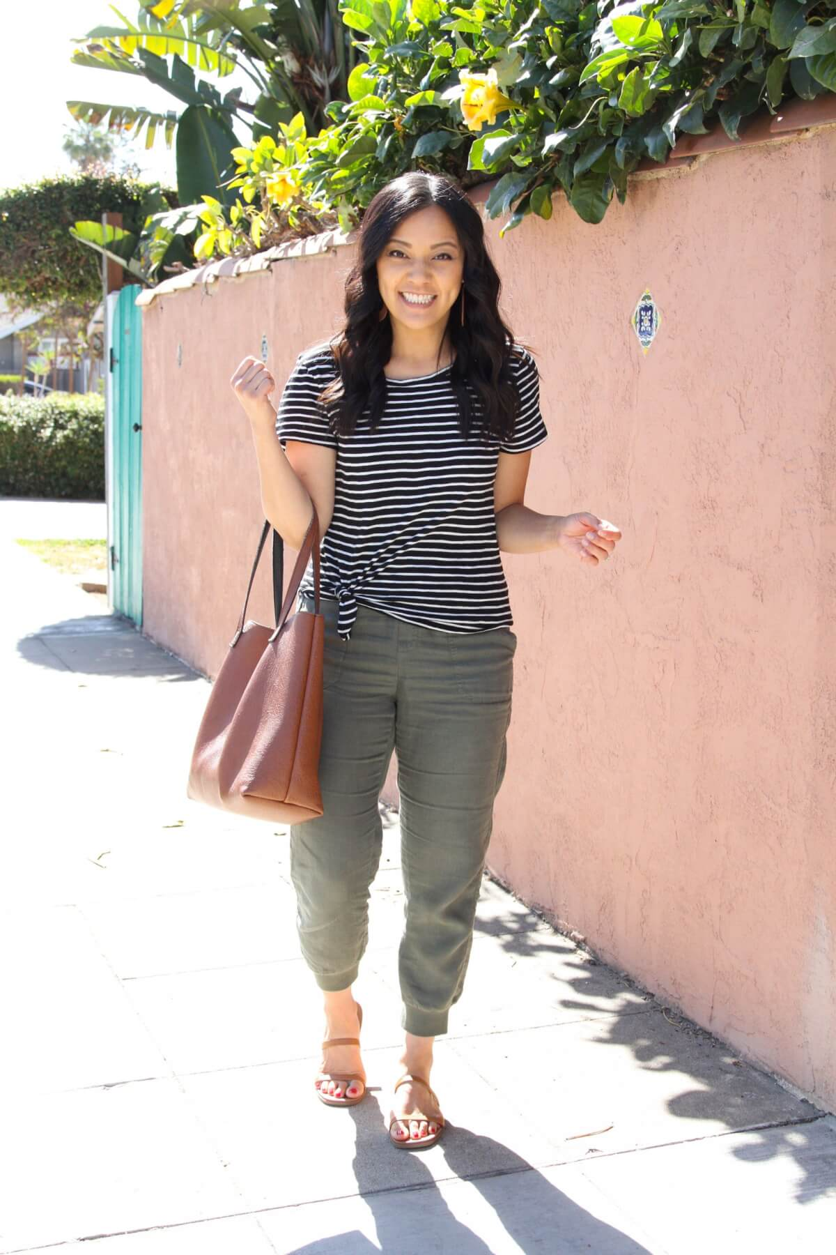 Casual Outfit: black and white striped tee + olive joggers + tan strappy sandals + tan tote + tan earrings