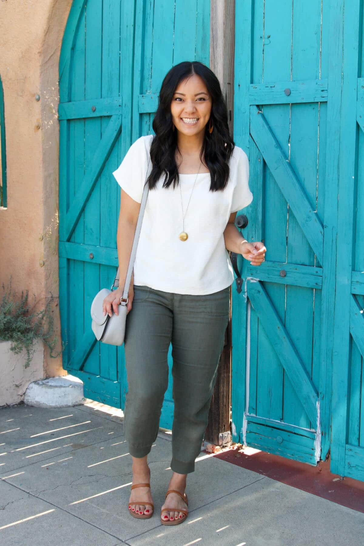 Elevated Casual Outfit: white square neck top + olive joggers + tan leather sandals + tan earrings + pendant necklace + grey crossbody bag