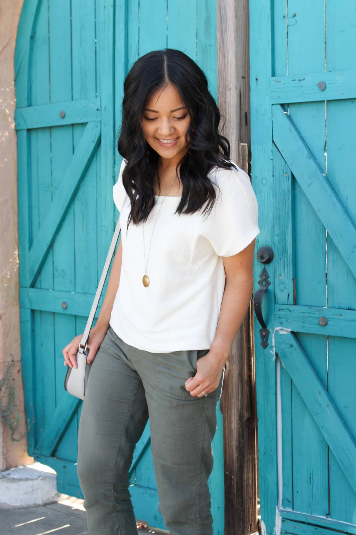 Elevated Casual Outfit: white square neck top + olive joggers + pendant necklace + grey crossbody bag