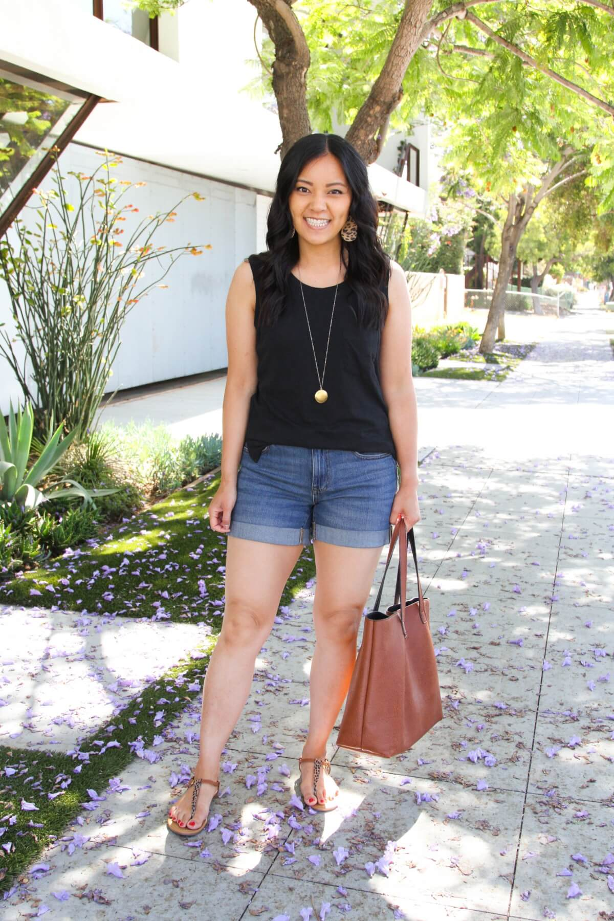 Casual Summer Outfit: black tank + denim shorts + t-strap sandals + leopard earrings + pendant necklace + tan tote bag