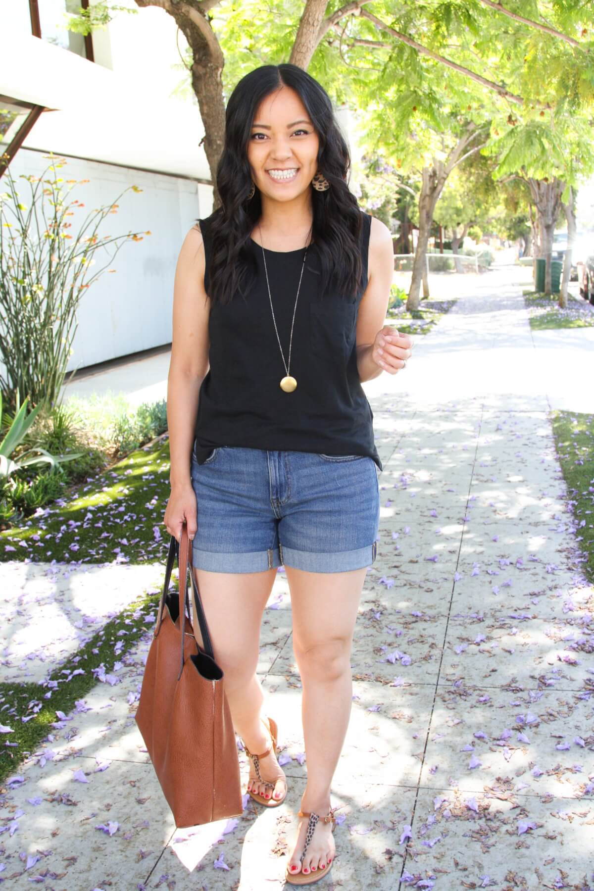 casual summer outfit: black tank + denim shorts + leopard and tan t-strap sandals + leopard earrings + pendant necklace + tan tote