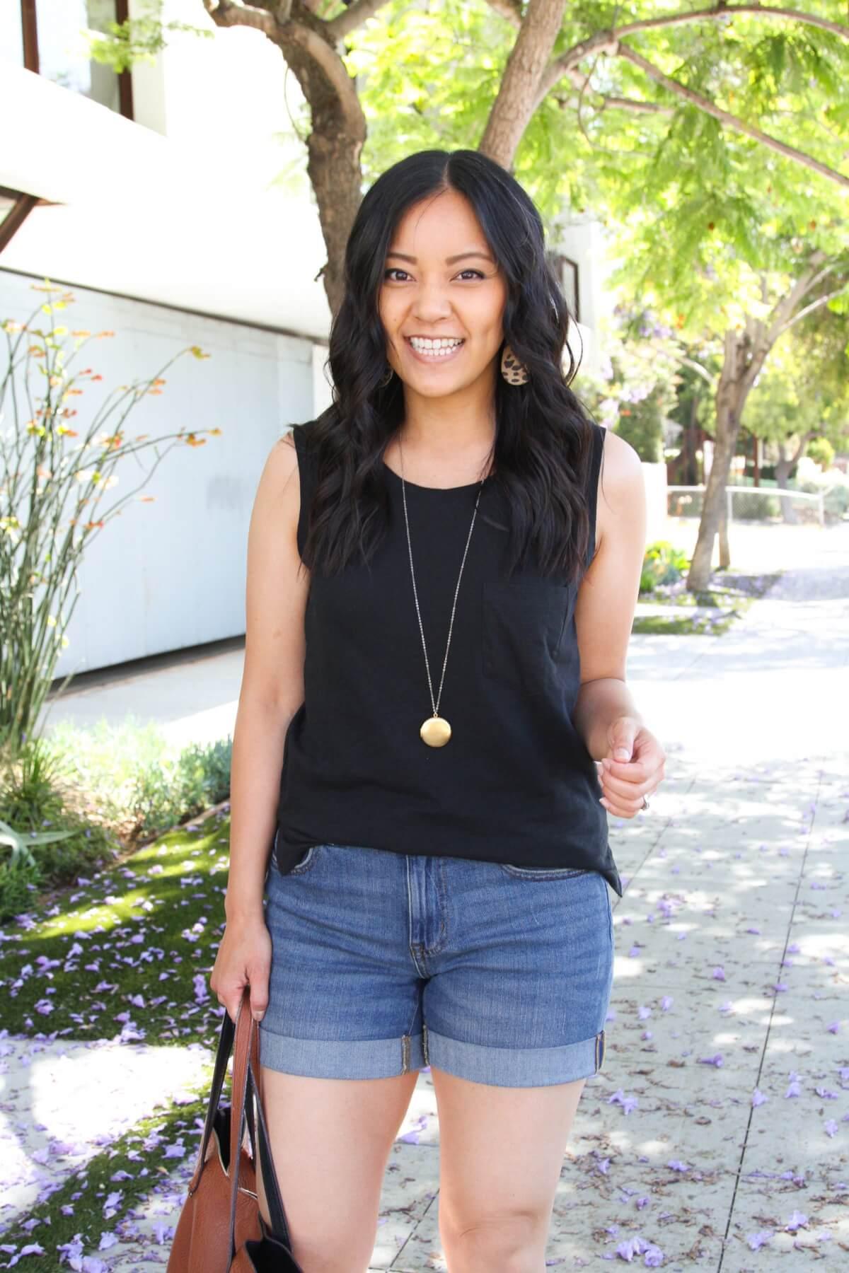 Casual Summer Outfit: black tank + denim shorts + leopard t-strap sandals + leopard earrings + pendant necklace + tan tote bag