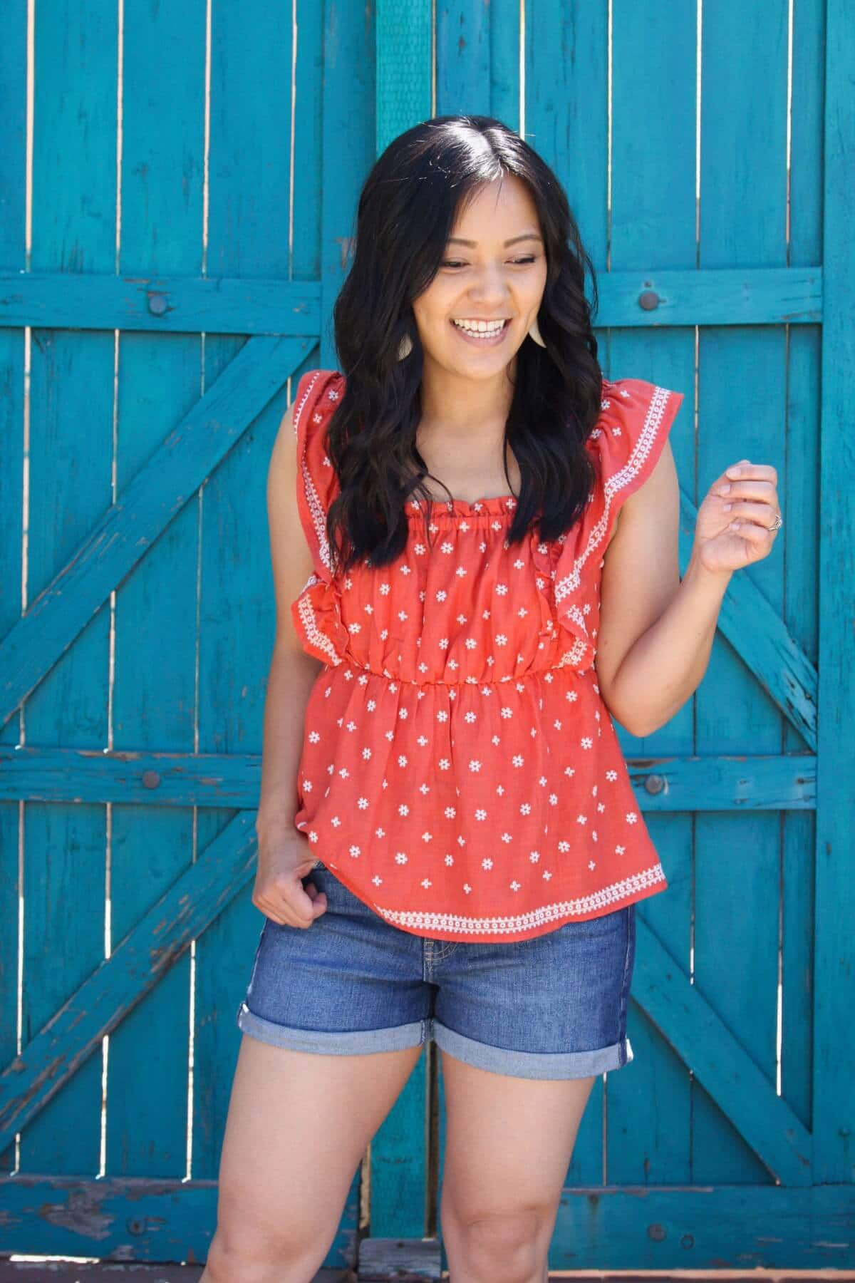 Elevated Casual Summer Outfit: red and white bandana tank + denim shorts + white earrings