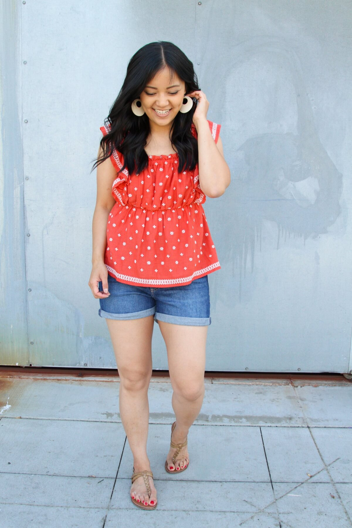 Elevated Casual Summer Outfit: red bandana ruffle peplum top + denim shorts + white earrings + brown t-strap sandals