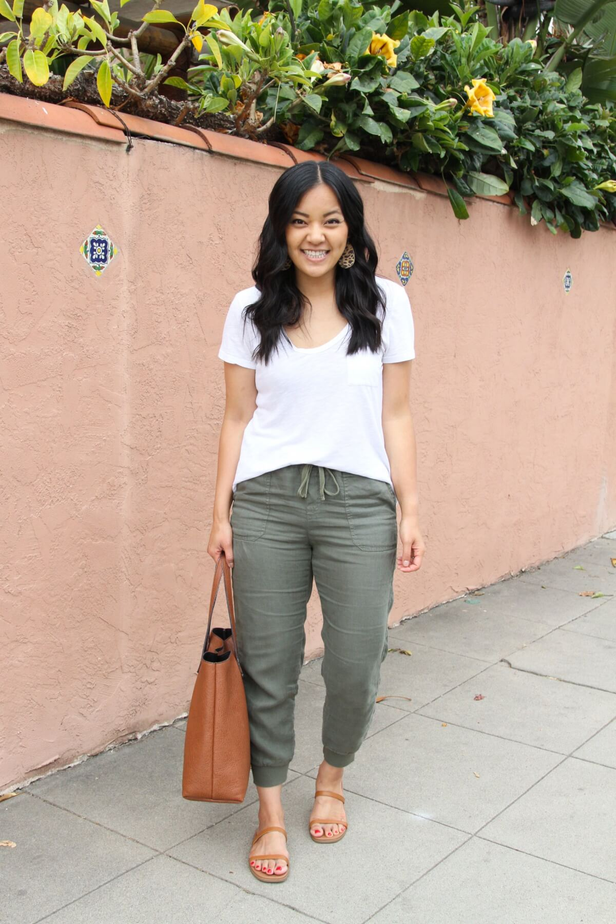 Casual Outfit: olive joggers + white tee + tan leather sandals + leopard earrings + tan tote