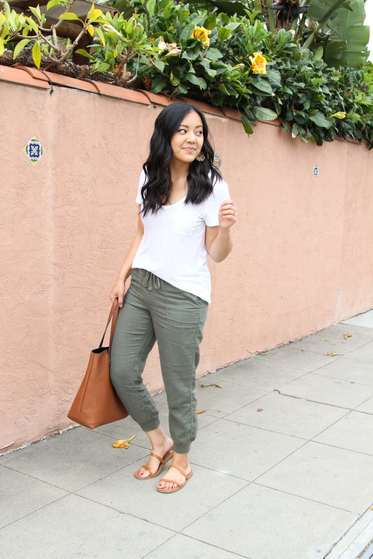 Casual Outfit: olive joggers + white tee + tan leather sandals + leopard earrings + tan tote side
