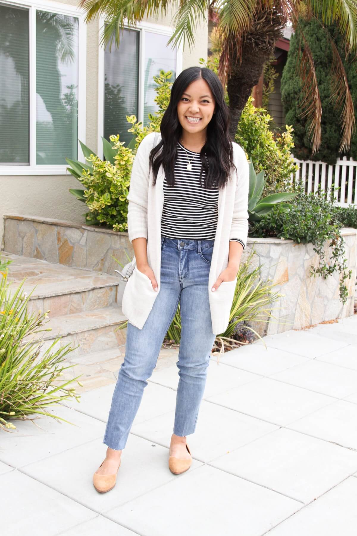 Comfy Casual Work Outfit: black and white striped long sleeve tee + jeans + cream cardigan + tan suede flats + gold pendant necklace + gray crossbody purse