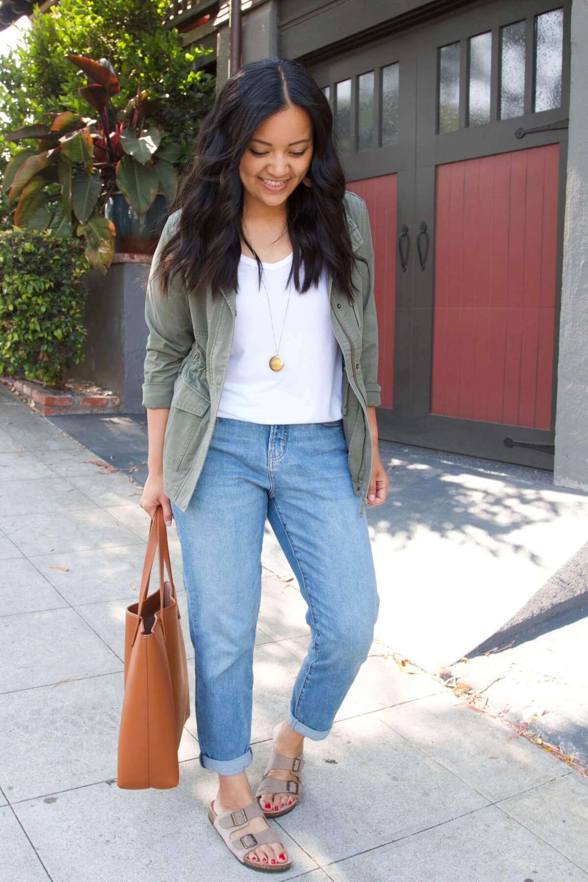 Casual Outfit: white tank + straight leg jeans + utility jacket + pendant necklace + tan tote + birkenstock type sandals
