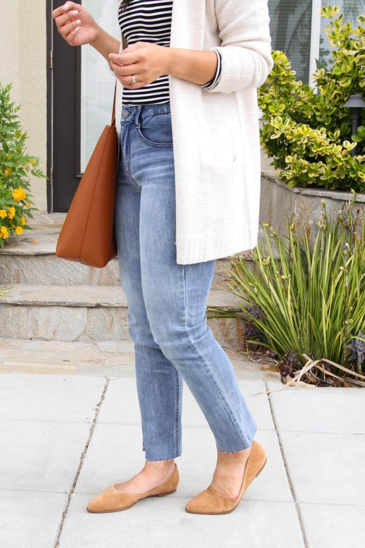 Nicer Casual Outfit: black and white striped long sleeve tee + light blue jeans + cream long cardigan + tan tote side