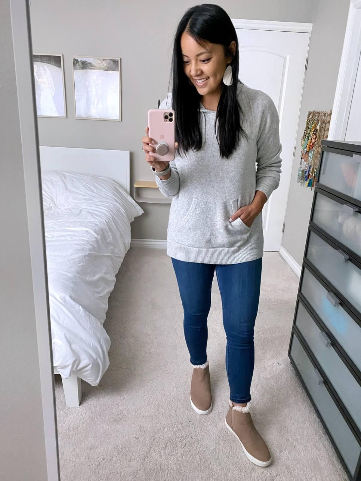 NSale Casual Outfit: gray hoodie sweatshirt + blue skinny jeans + nude shearling-lined booties + white earrings