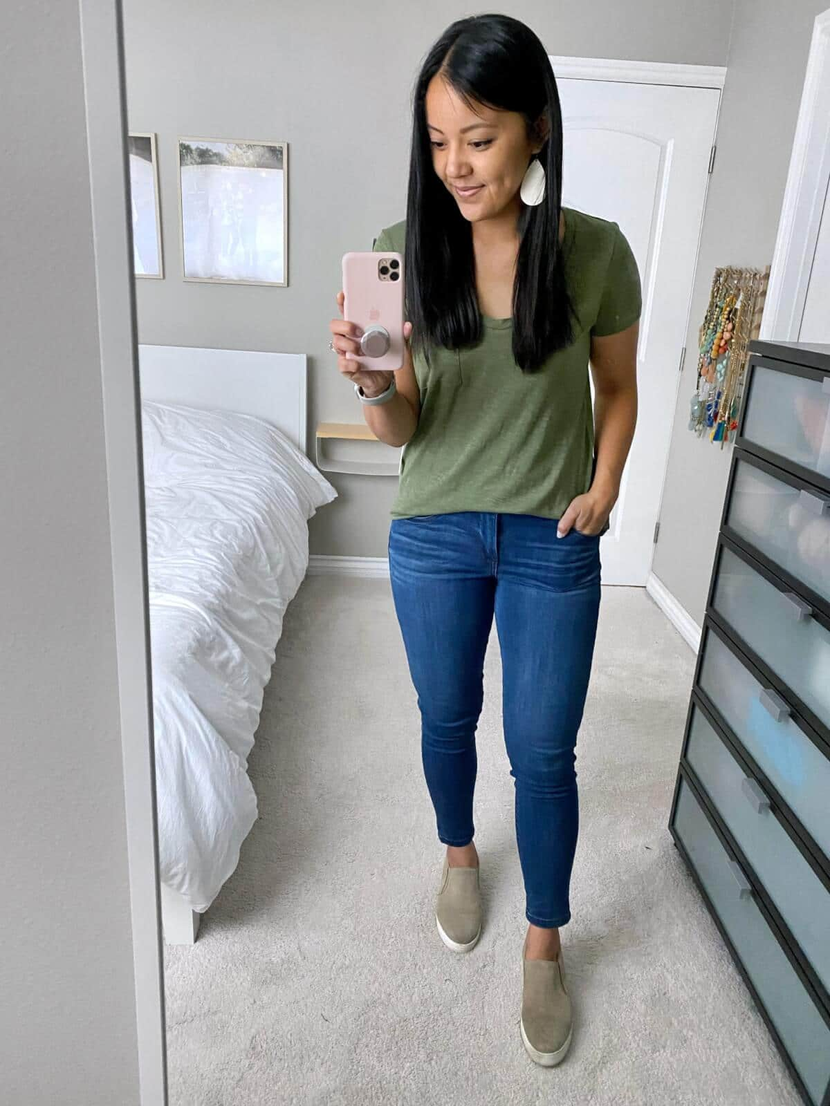 NSale Casual Outfit: olive tee + blue skinny jeans + nude slip-on sneakers + white earrings