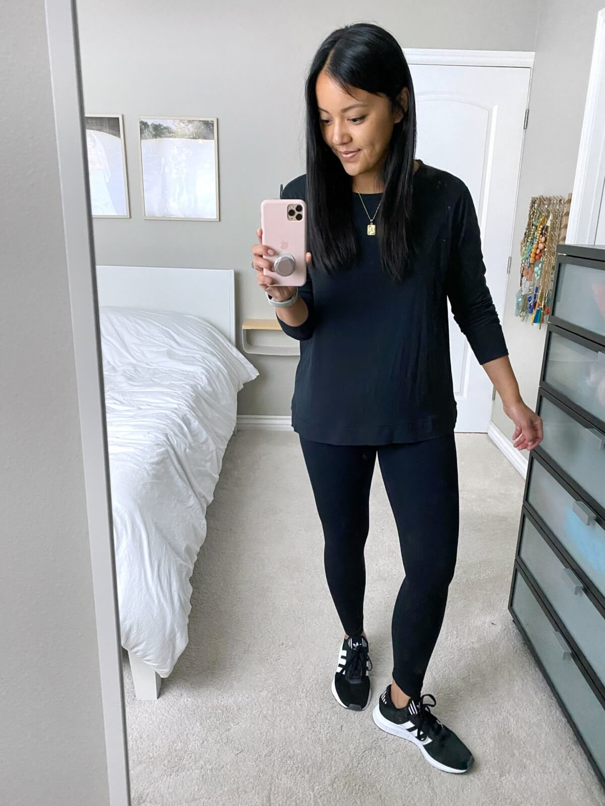 NSale Casual Athleisure Outfit: navy sweatshirt + black leggings + black sneakers + gold initial pendant necklace
