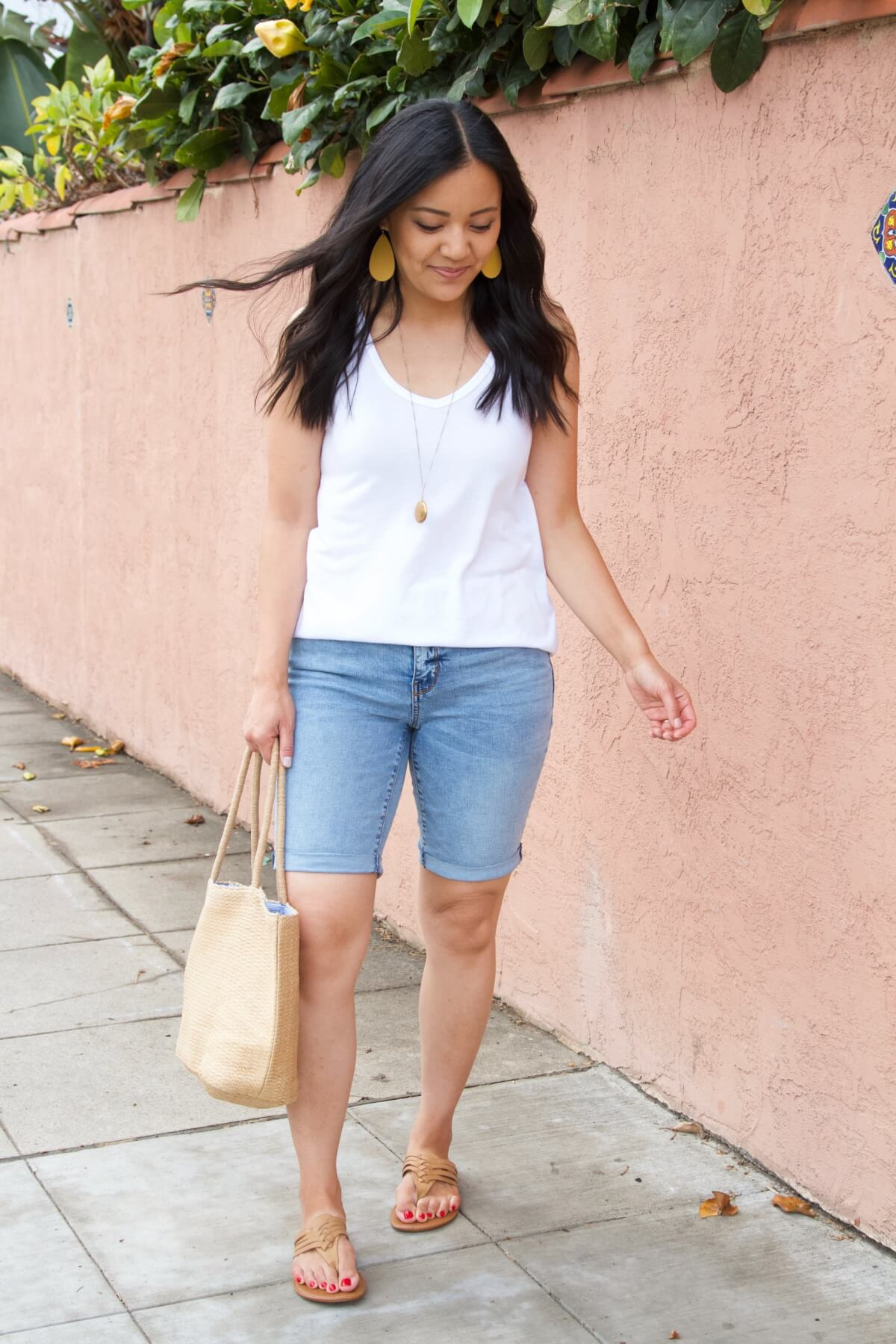 Casual Summer Outfit: white tank + denim shorts + leather braided flip-flops + yellow earrings + pendant necklace + straw tote