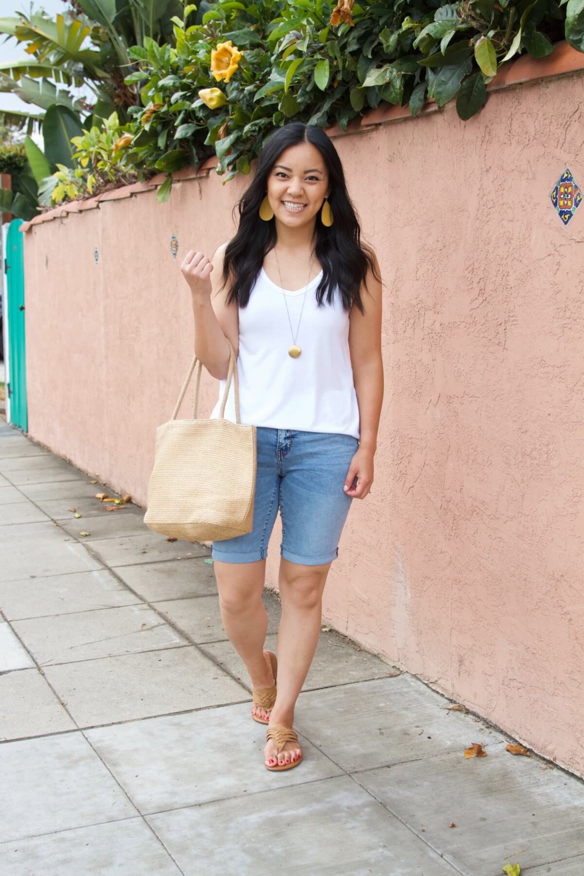 Casual Summer Outfit: white tank + denim shorts + leather thong sandals + yellow earrings + pendant necklace + straw tote