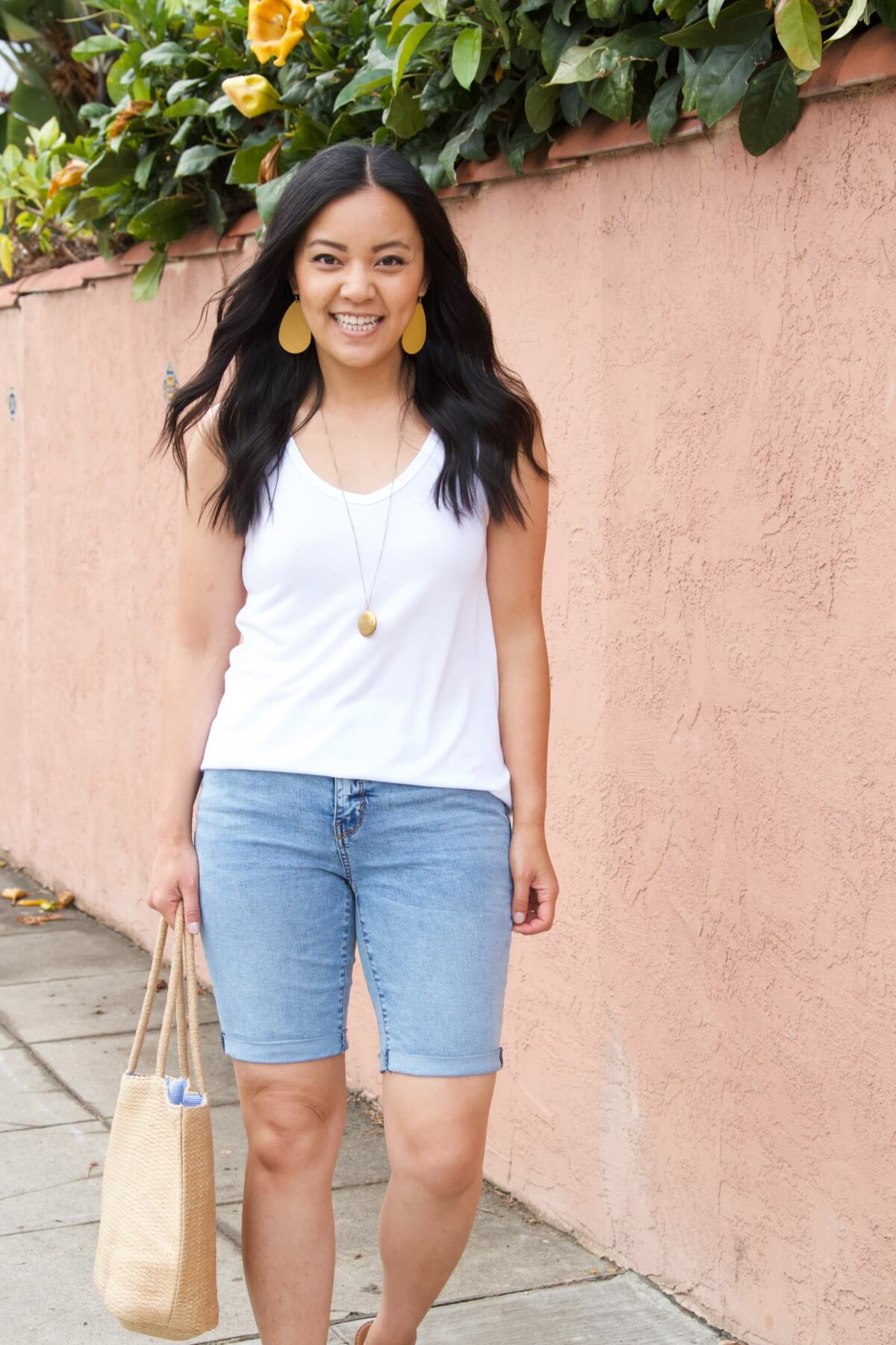 Casual Summer Outfit: white tank + denim shorts + yellow earrings + pendant necklace + straw tote