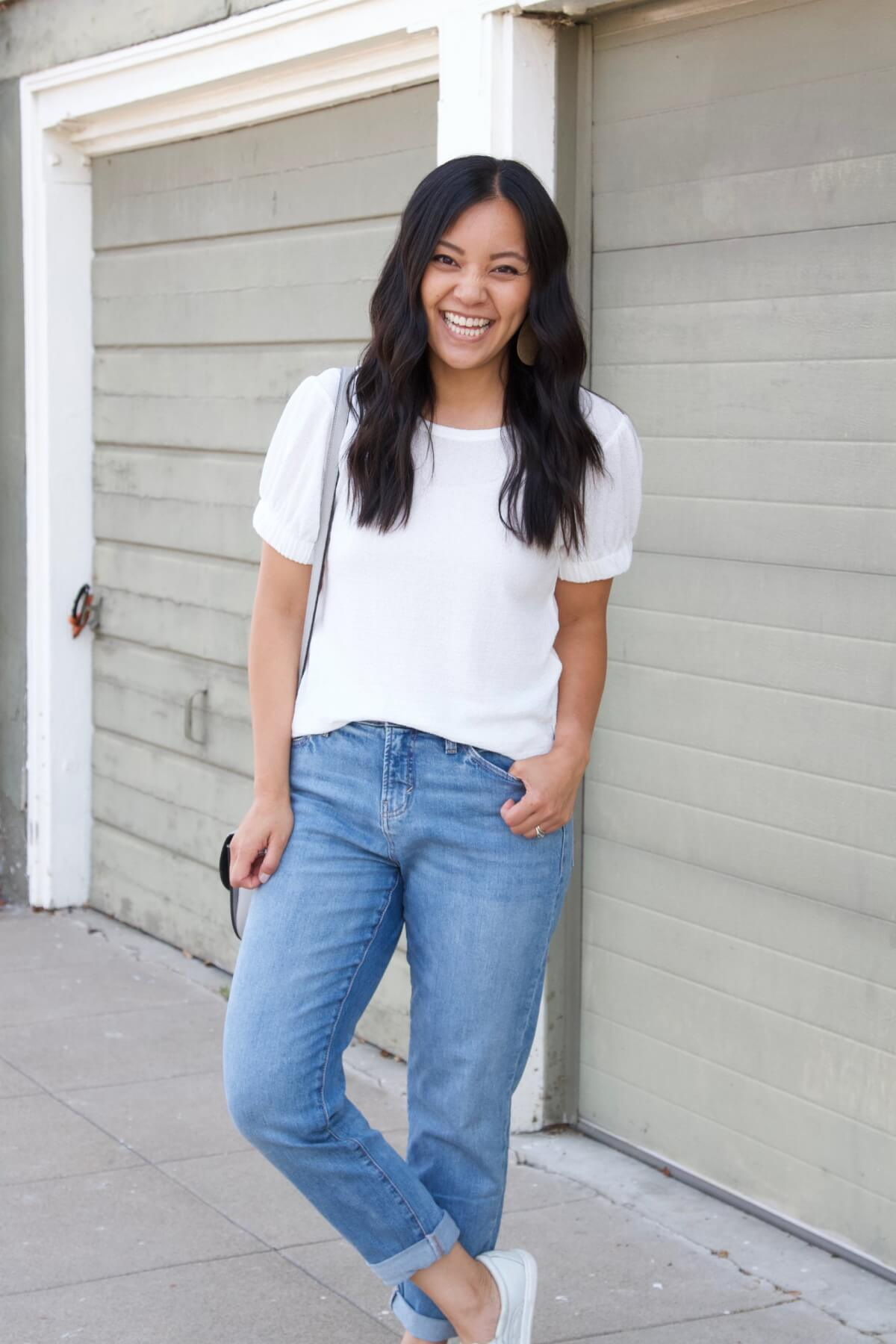 nicer casual outfit Summer to Early Fall Transition: white puff sleeve top + light denim + white slip-on sneakers + gray crossbody purse