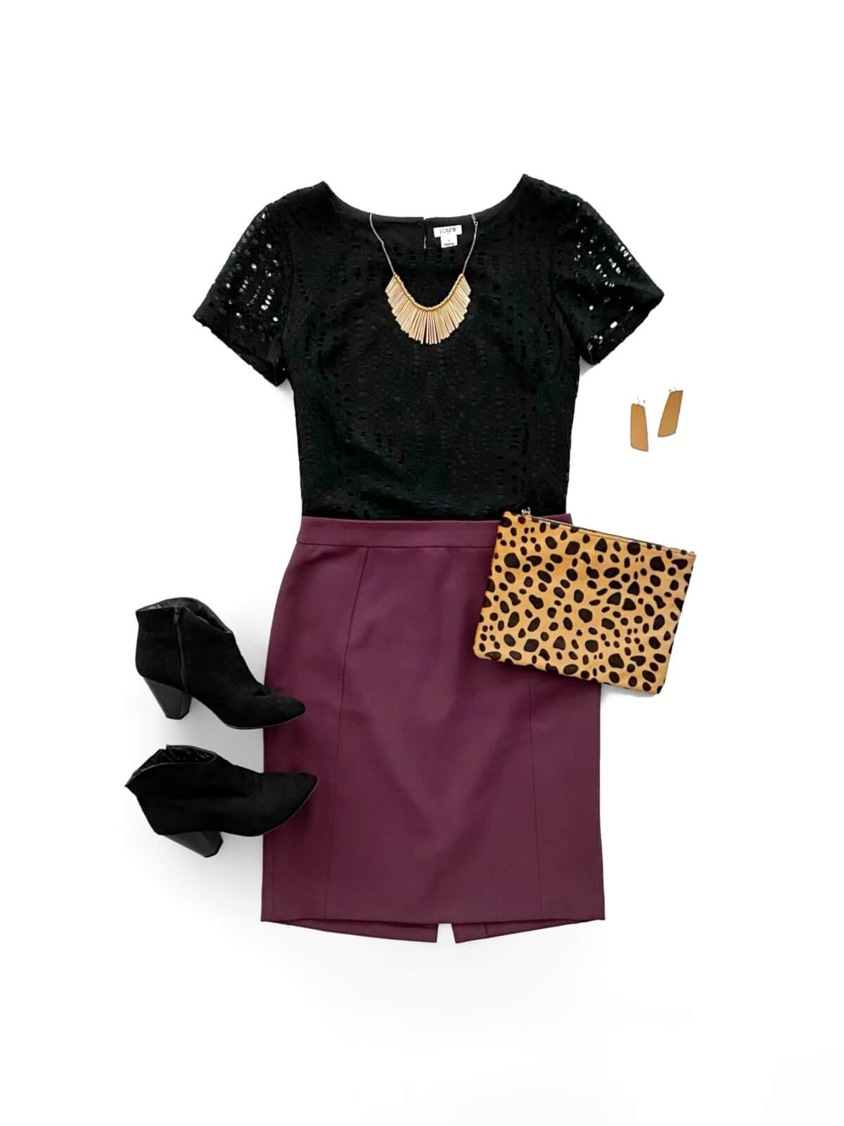 Dressy Outfit: solid-colored top black blouse + maroon skirt + black booties + gold statement necklace + gold earrings + leopard clutch flat lay