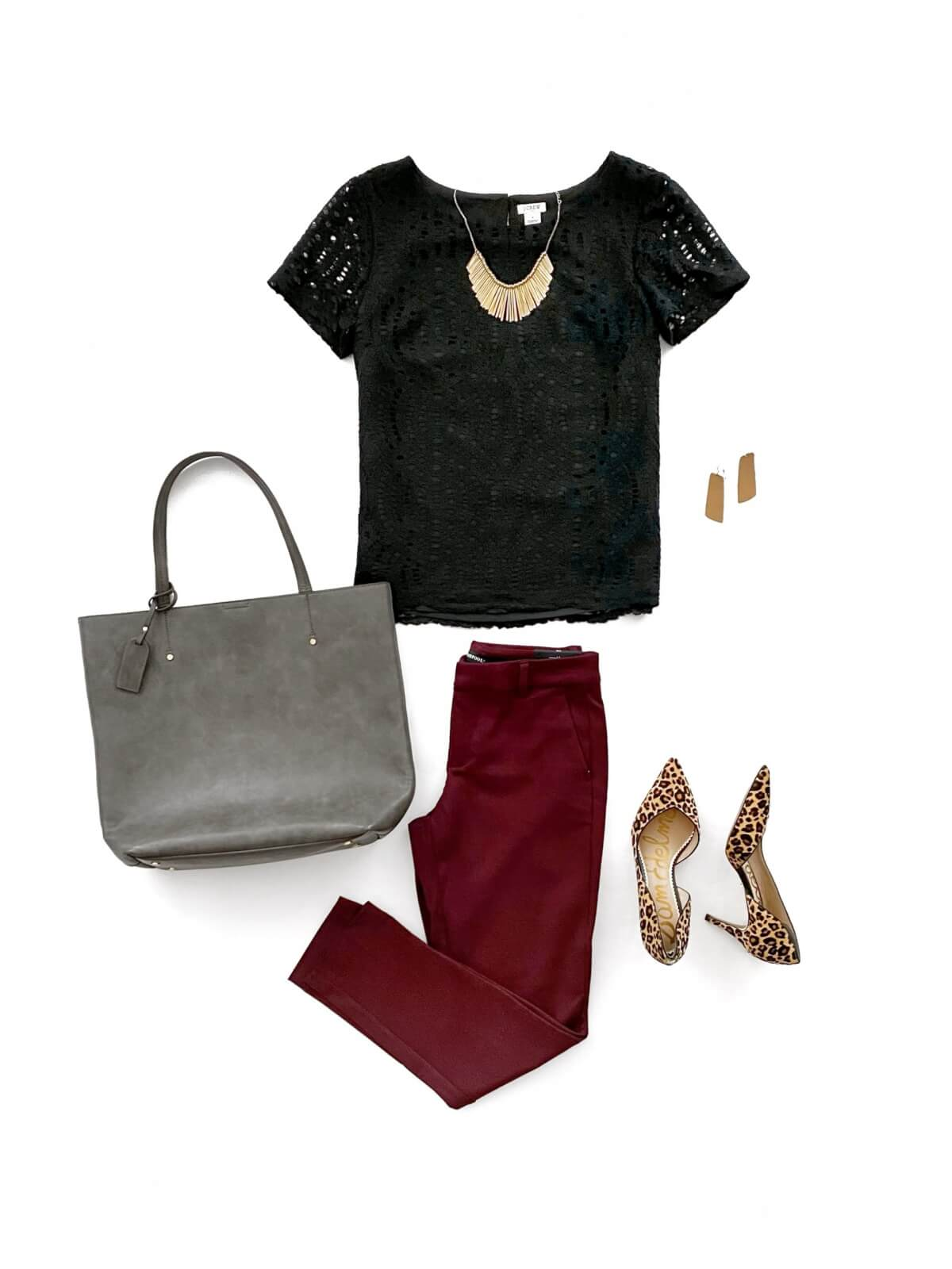 Business Casual Outfit: solid-colored top black blouse + maroon slacks + leopard heels + gold statement necklace + gold earrings + gray tote flat lay