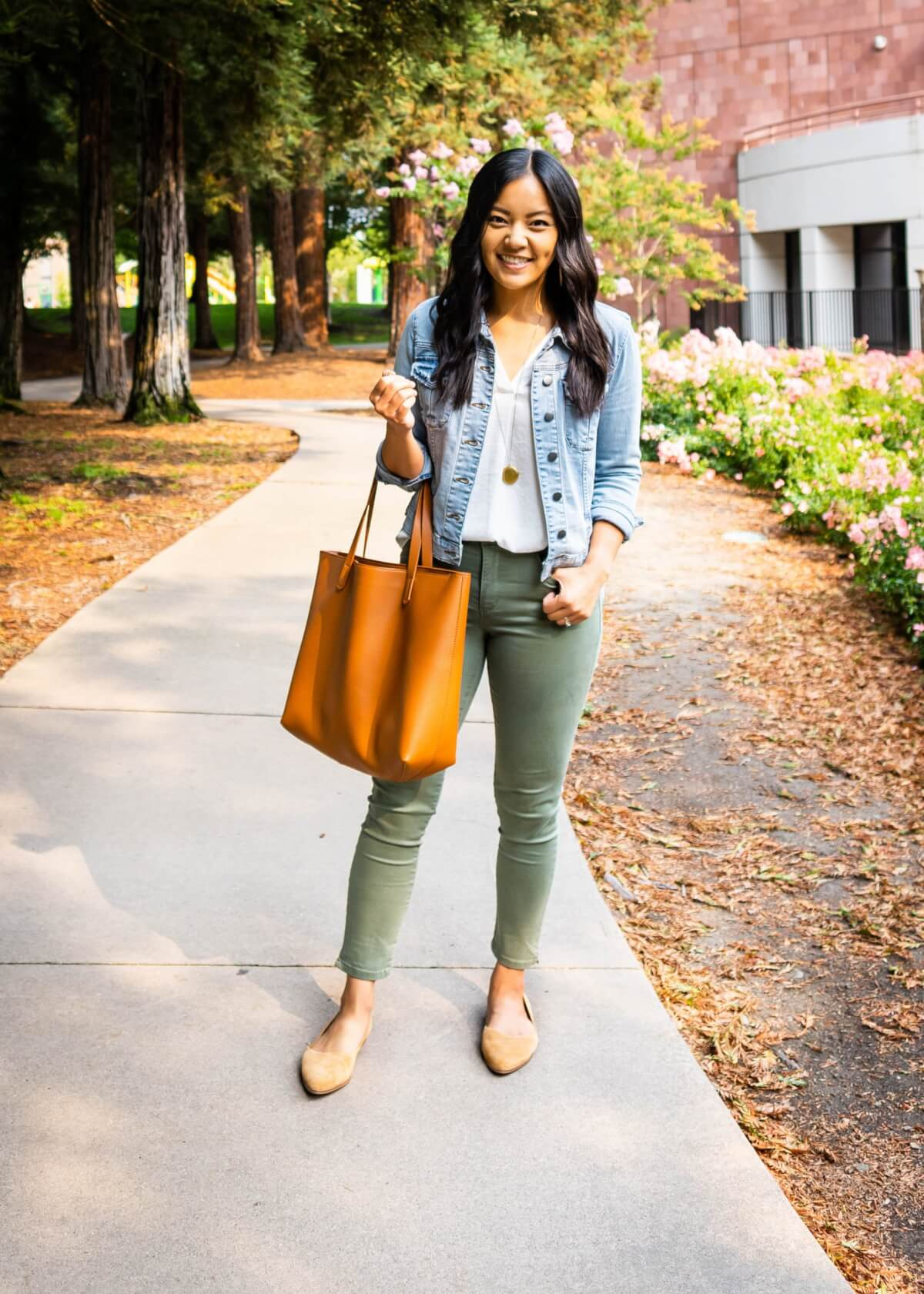 Comfy Work Casual Outfit: white blouse + olive chinos + denim jacket + tan suede flats + gold pendant necklace + tan tote