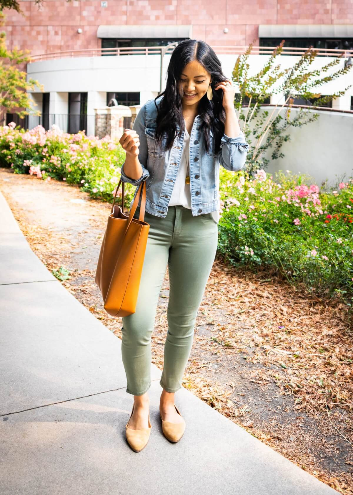 Comfy Work Casual Outfit: white blouse + olive chinos + denim jacket + tan suede flats + gold pendant necklace + tan tote + gold leather earrings