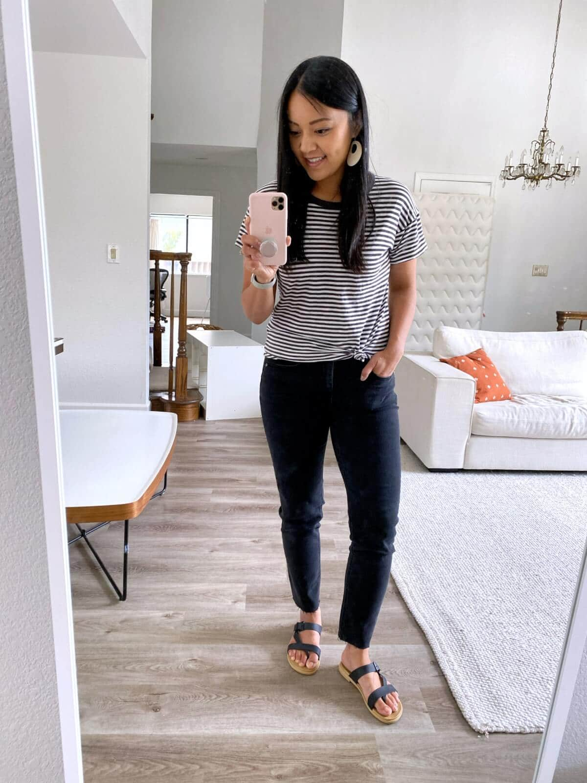 Summer to Fall Transition Casual Outfit: black and white striped t-shirt + black straight leg jeans + black strappy Crocs + white earrings