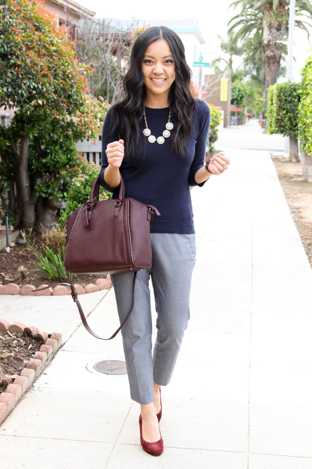 Business Casual Outfit: solid-colored top navy sweater + gray slacks + leopard heels + statement bib necklace + maroon bag + maroon heels